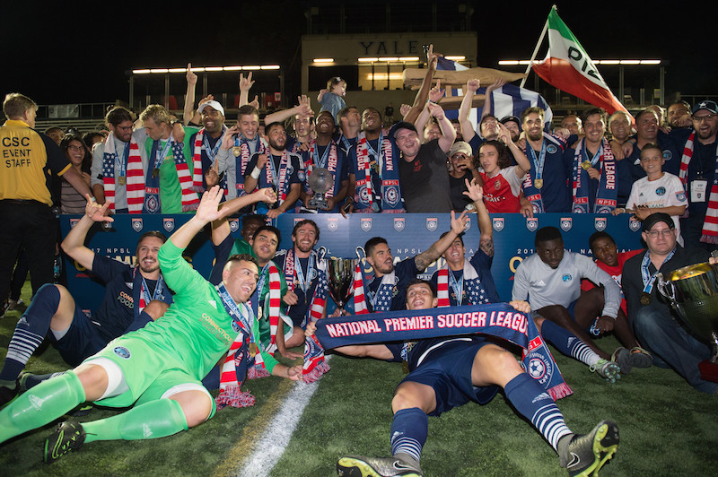 Members of the Elm City Express celebrating their National Premier Soccer League championship.