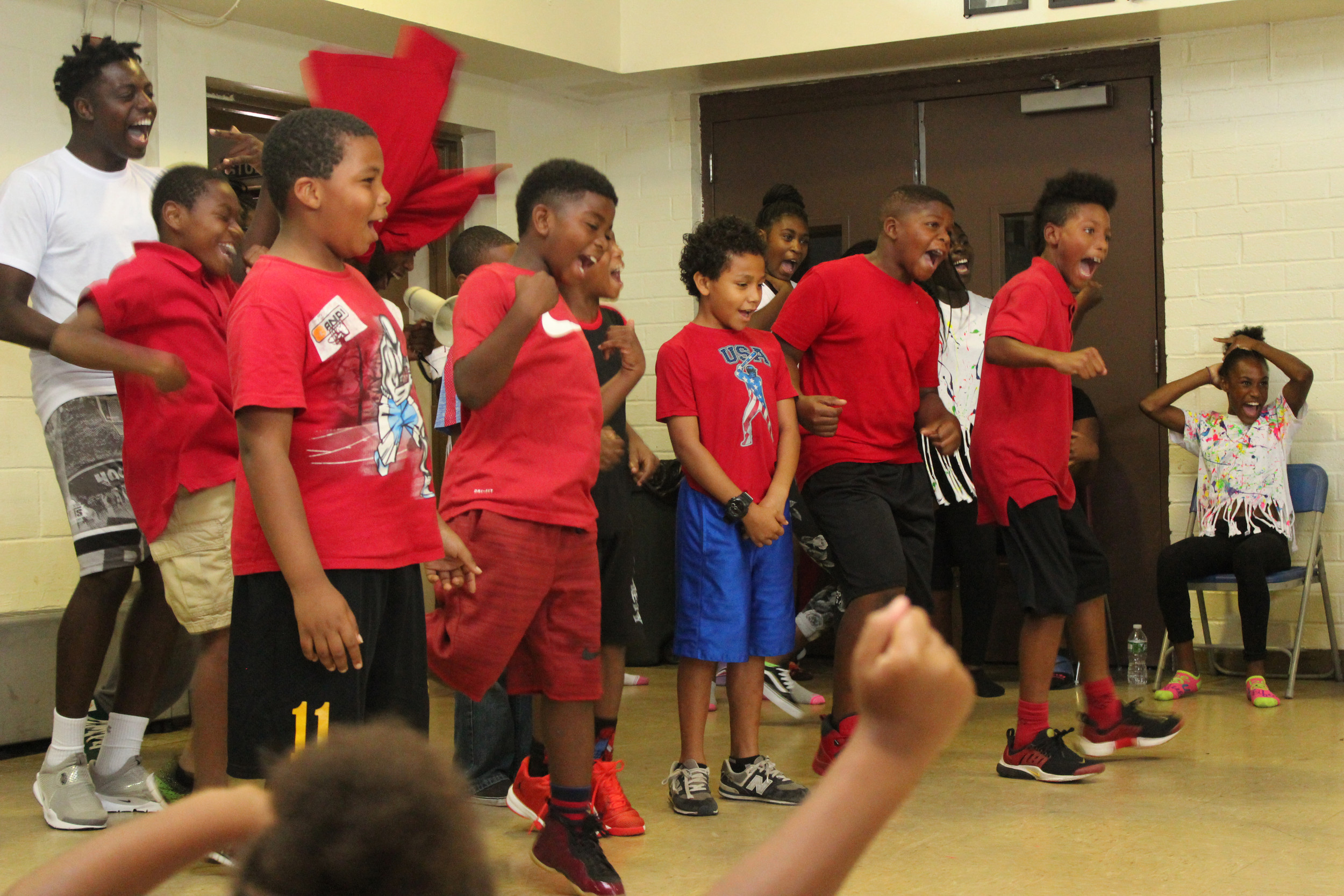 Boys at the MLK Center's summer camp program cheered on their friends during a dance off.