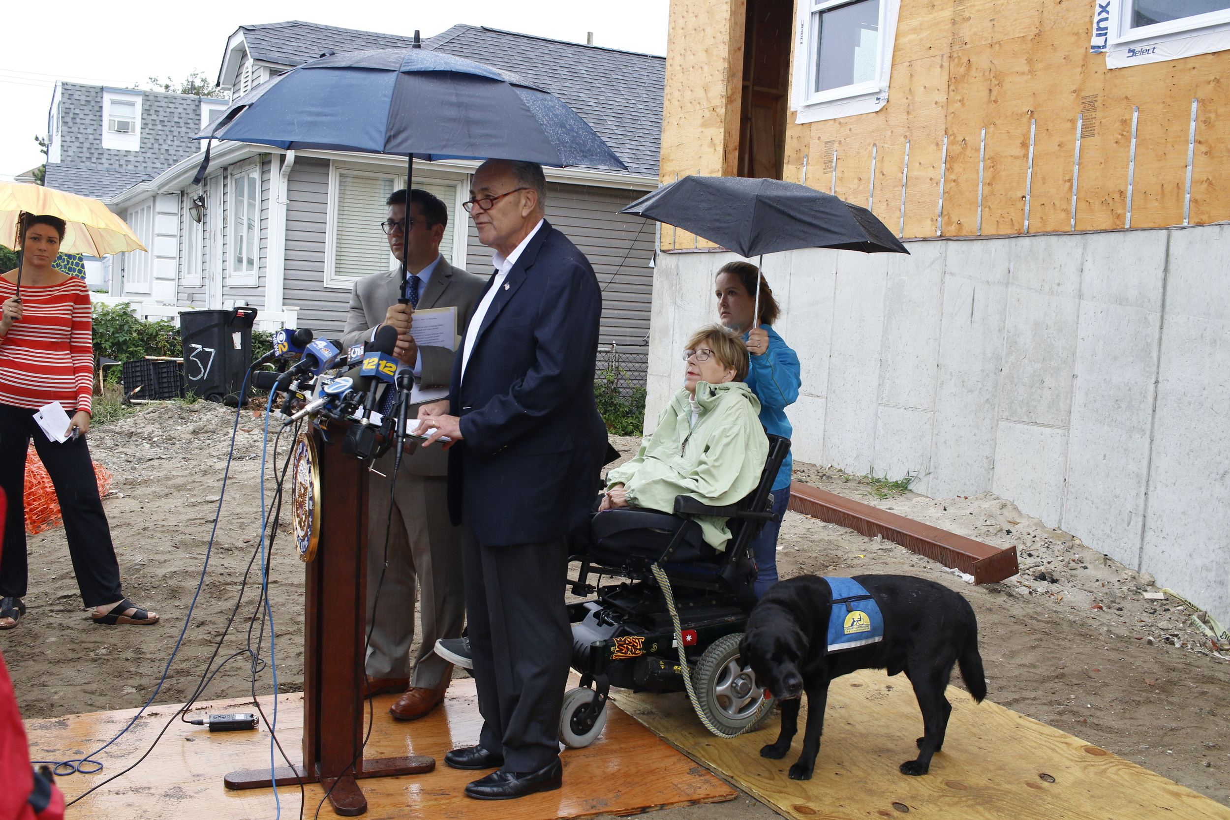 U.S. Sen. Chuck Schumer spoke in front of the unfinished home of Long Beach resident Liz Treston on Aug. 29, 