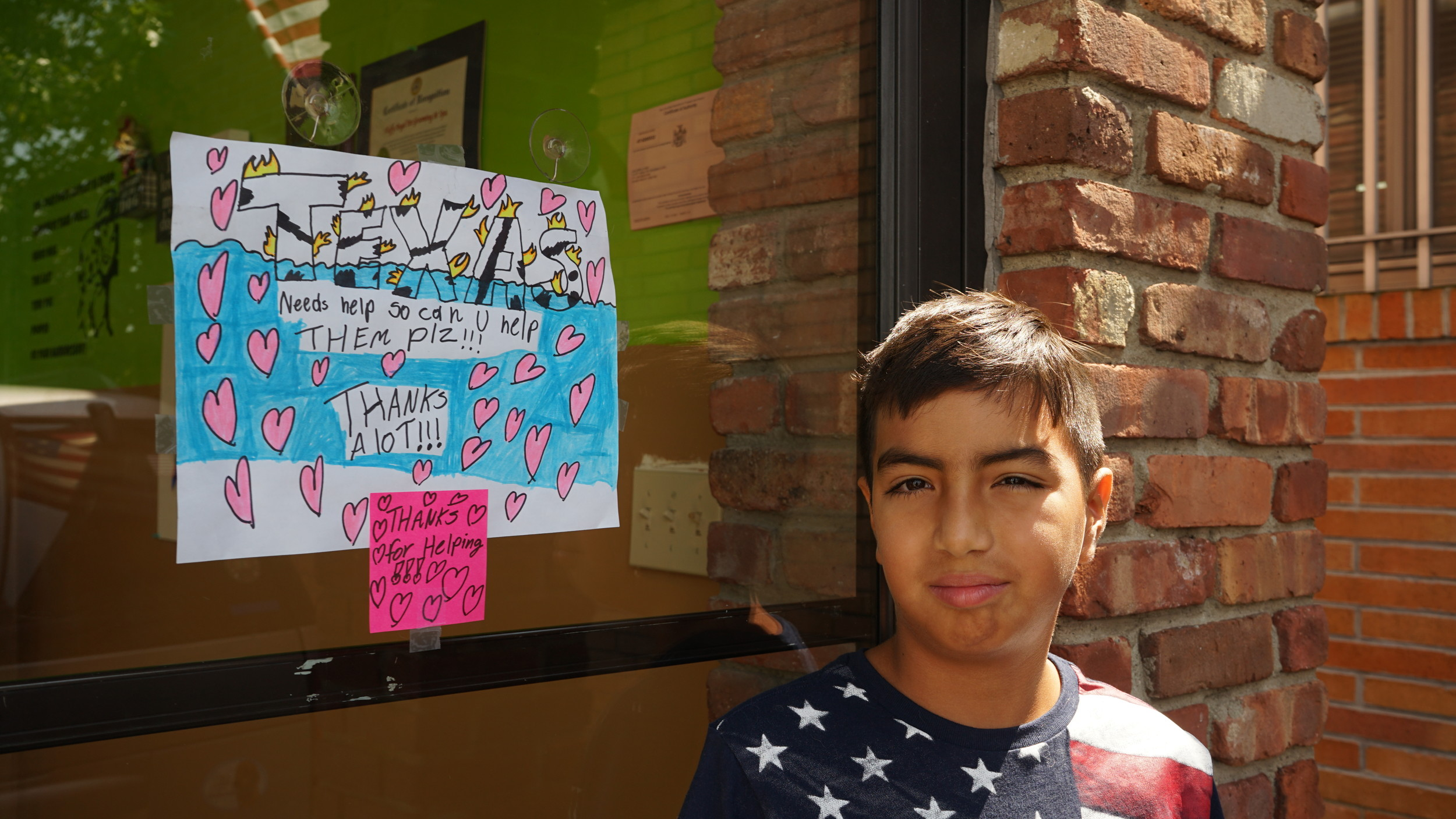 "10-year-old Island Park resident Juan Zapelli, 10, is helping to set up a pet supply collection drive at his father's pet grooming business in Island Park. ""All of the people are struggling to survive,"" he said of the flood victims in Texas."
