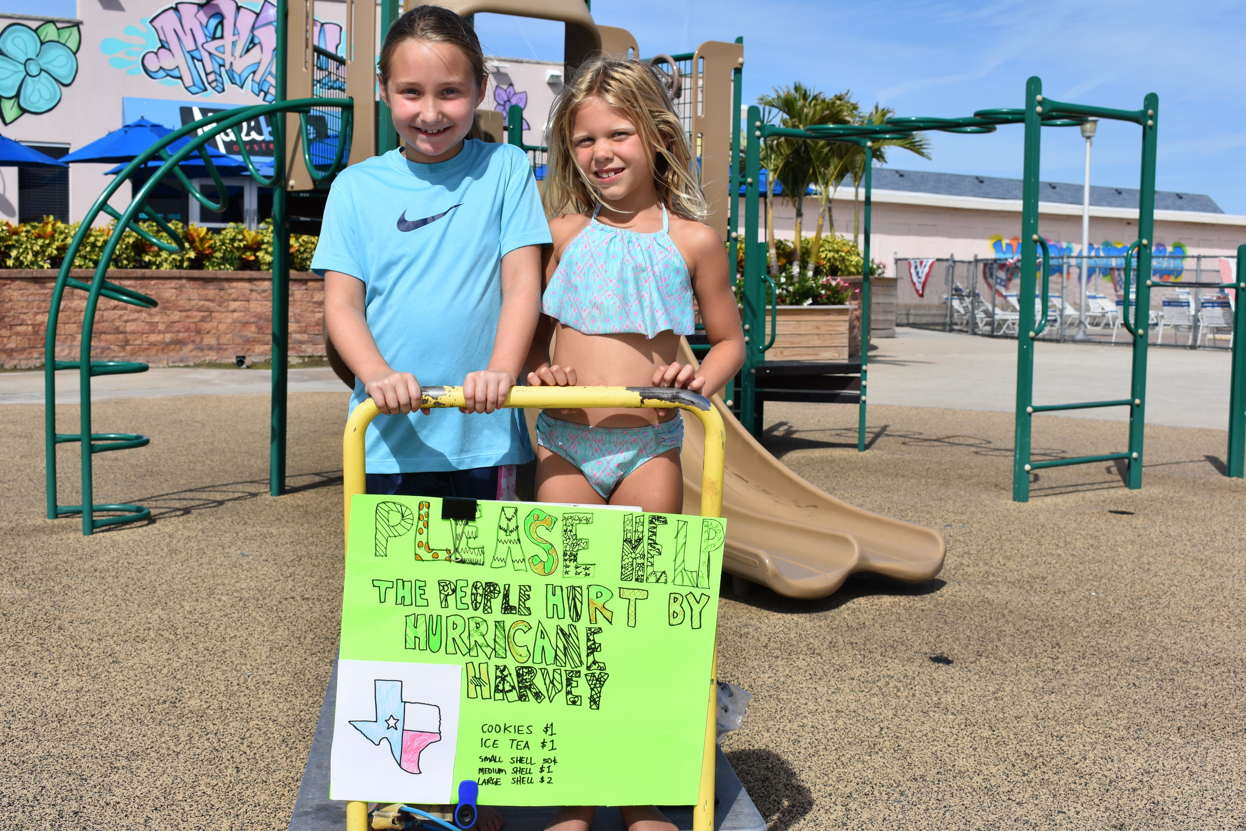 Rockville Centre resident  Kiersten Brull, 7, right, with her friend Maeve Martin, raised money for Hurricane Harvey victims by selling seashells, iced tea and cookies.