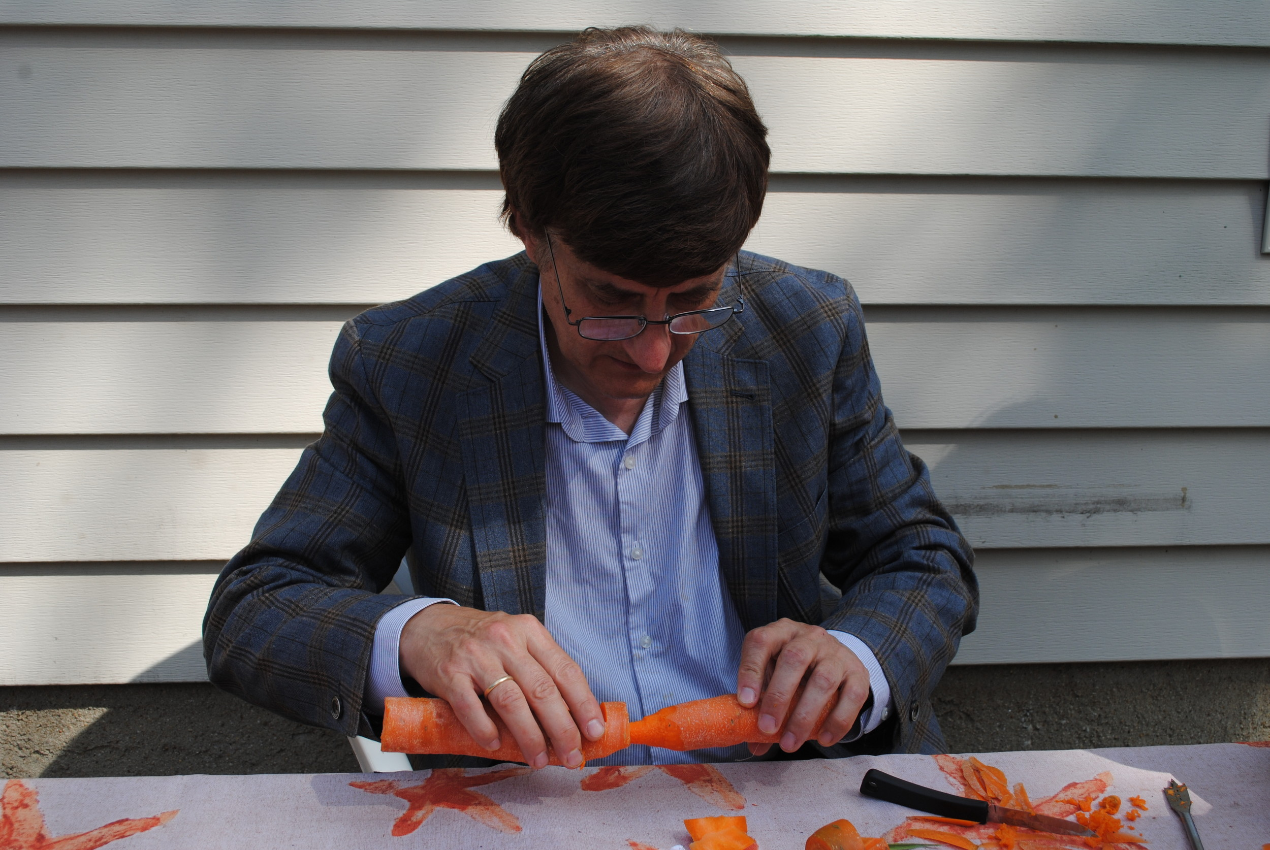 Dr. Dale Stuckenbruck, one of the orchestra chairs, spent time shaving down a carrot to the perfect size with a knife.