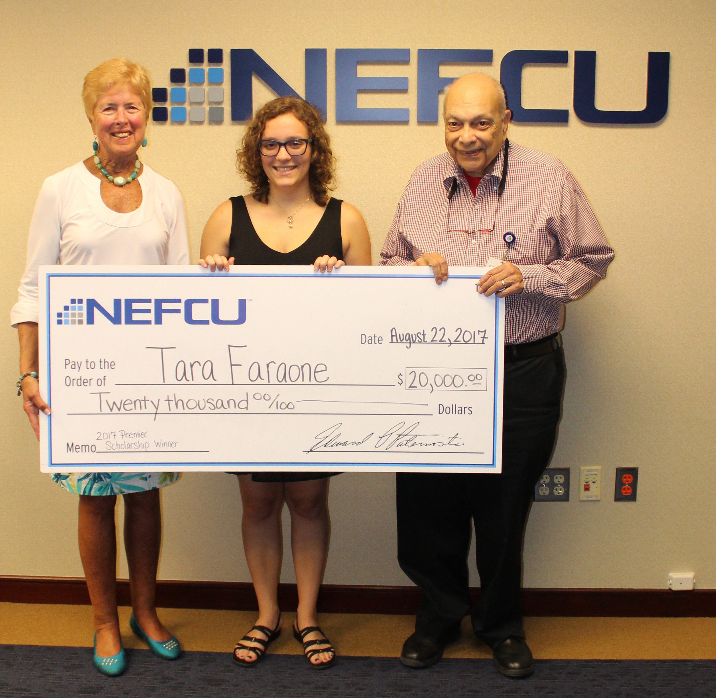 Tara Faraone was presented with a ceremonial scholarship check at NEFCU's Westbury headquarters on Aug. 22. With her were Suzanne Boehmcke, vice chair of both the Supervisory Committee and the Scholarship Committee, and Dr. William J. Russo, secretary of the NEFCU board of directors and chairman of the Scholarship Committee.