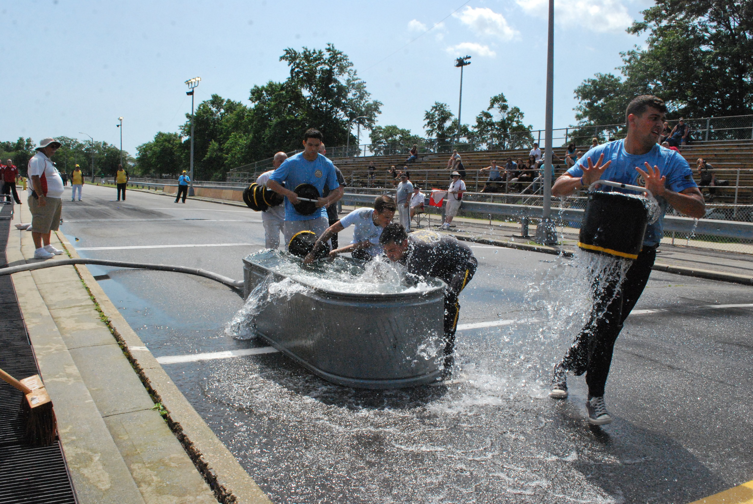 Members of the North Bellmore Fire Department hurried to fill their buckets in a friendly race against the nine other fire departments competing in the 6th Battalion's Old Fashioned Drill.