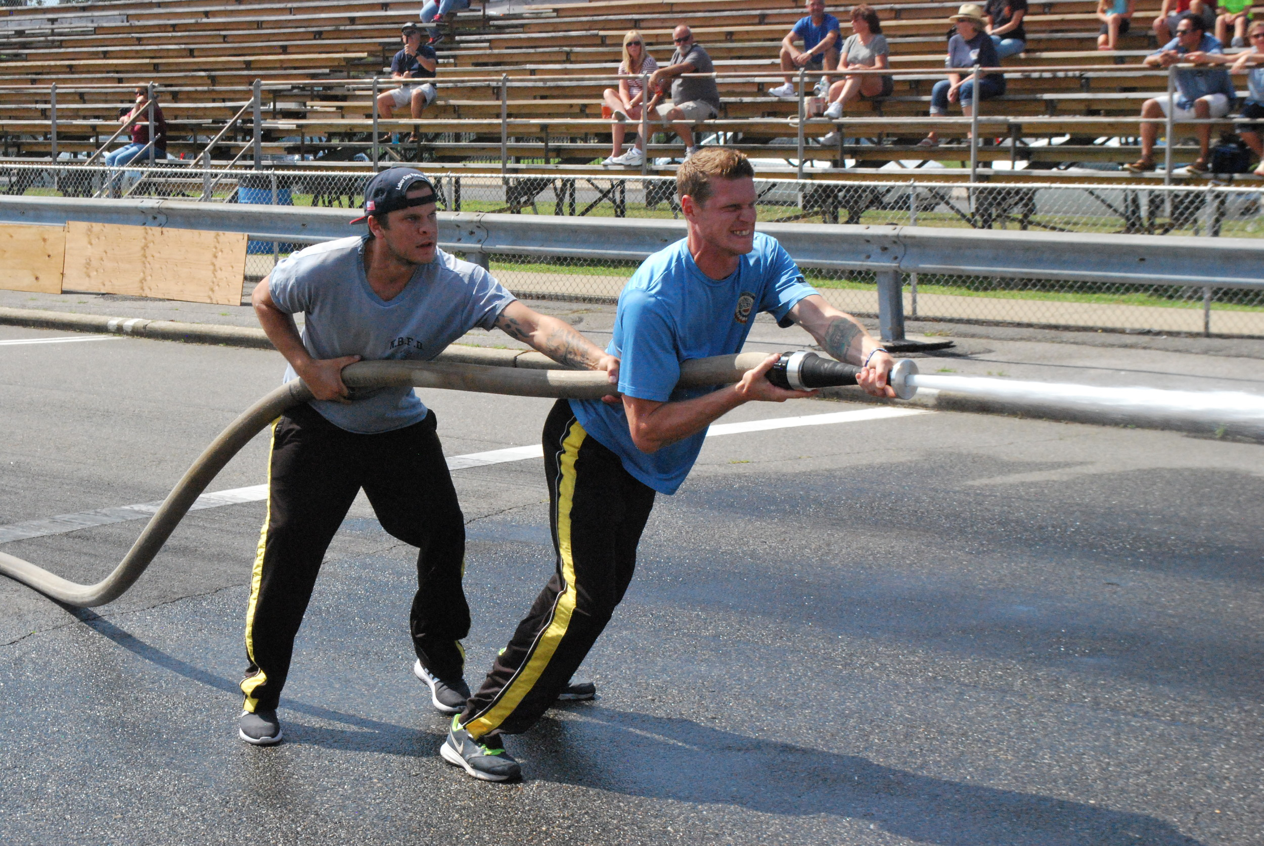 Joe and Sean Corcoran, both of the North Bellmore Fire Department, showed off their speed, strength and cooperation skills in the 6th Battalion's Old Fashioned Drill.