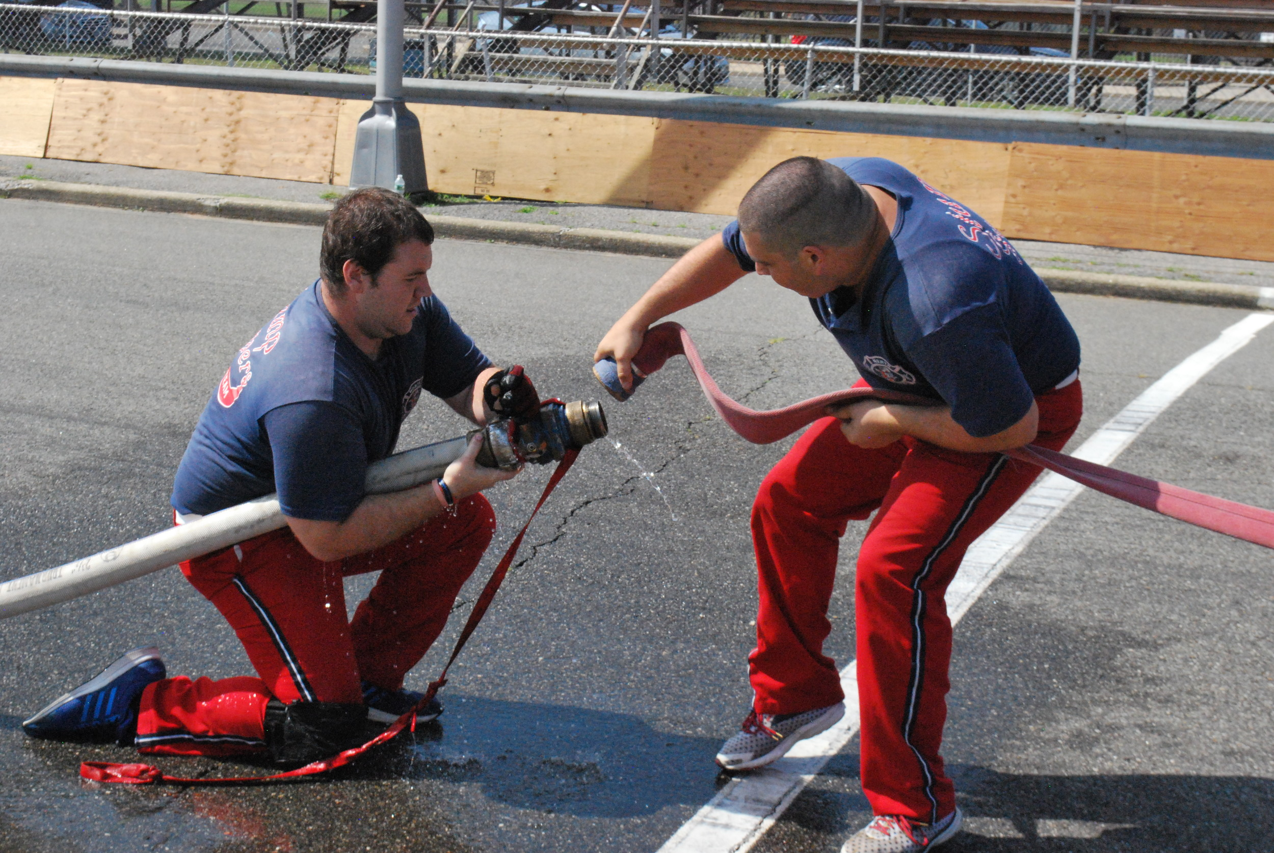 Scott McLaughlin and Anthony Wilders, both of the North Merrick Fire Department, worked together to set up their team's fire hose.