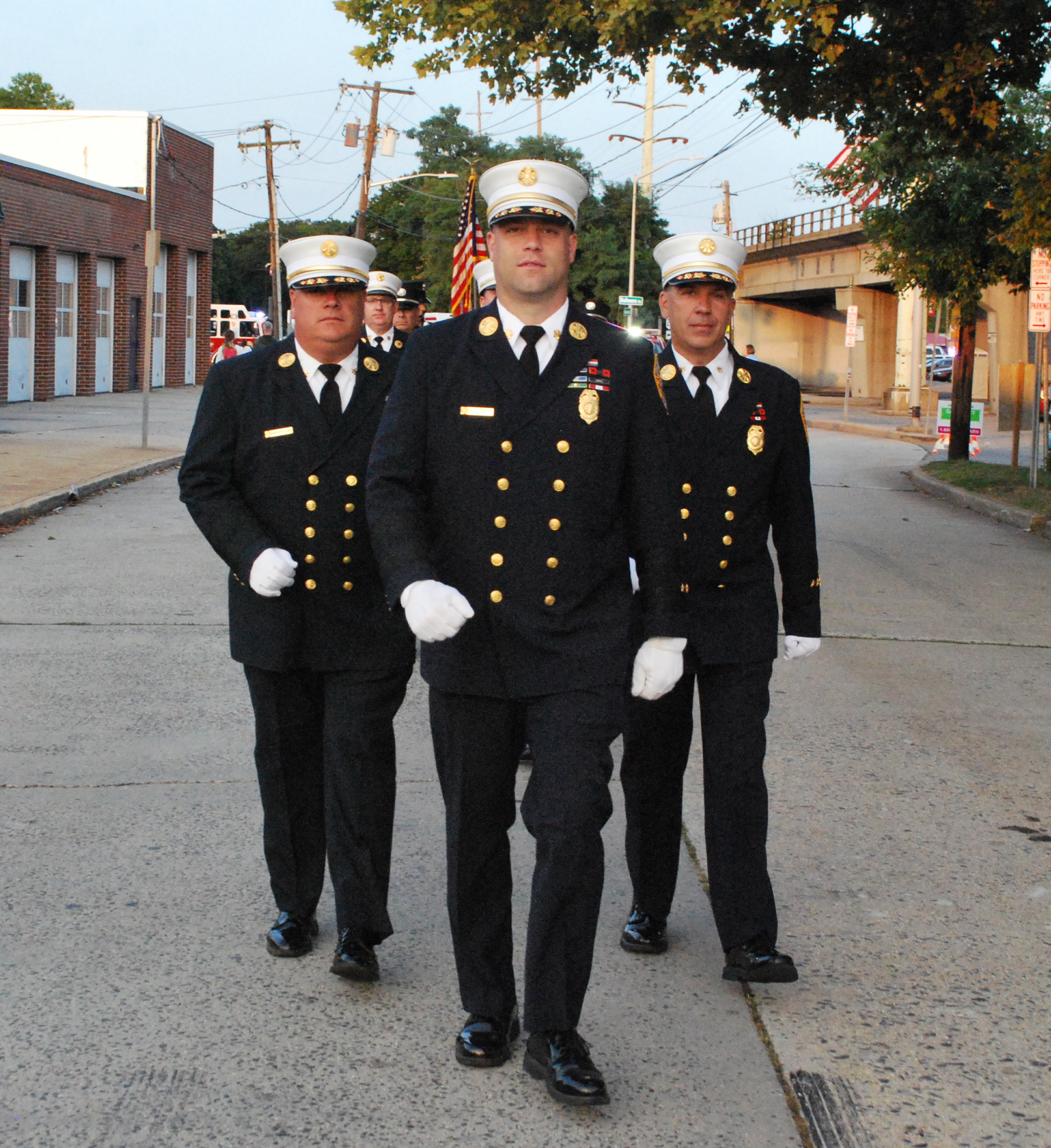 Chief Brian Ellensohn, left, First Assistant Chief Robert Presti Jr., and Second Assistant Chief Chris Fasano, all of the North Merrick Fire Department, marched down the streets of Bellmore during the 6th Battalion's annual Parade.