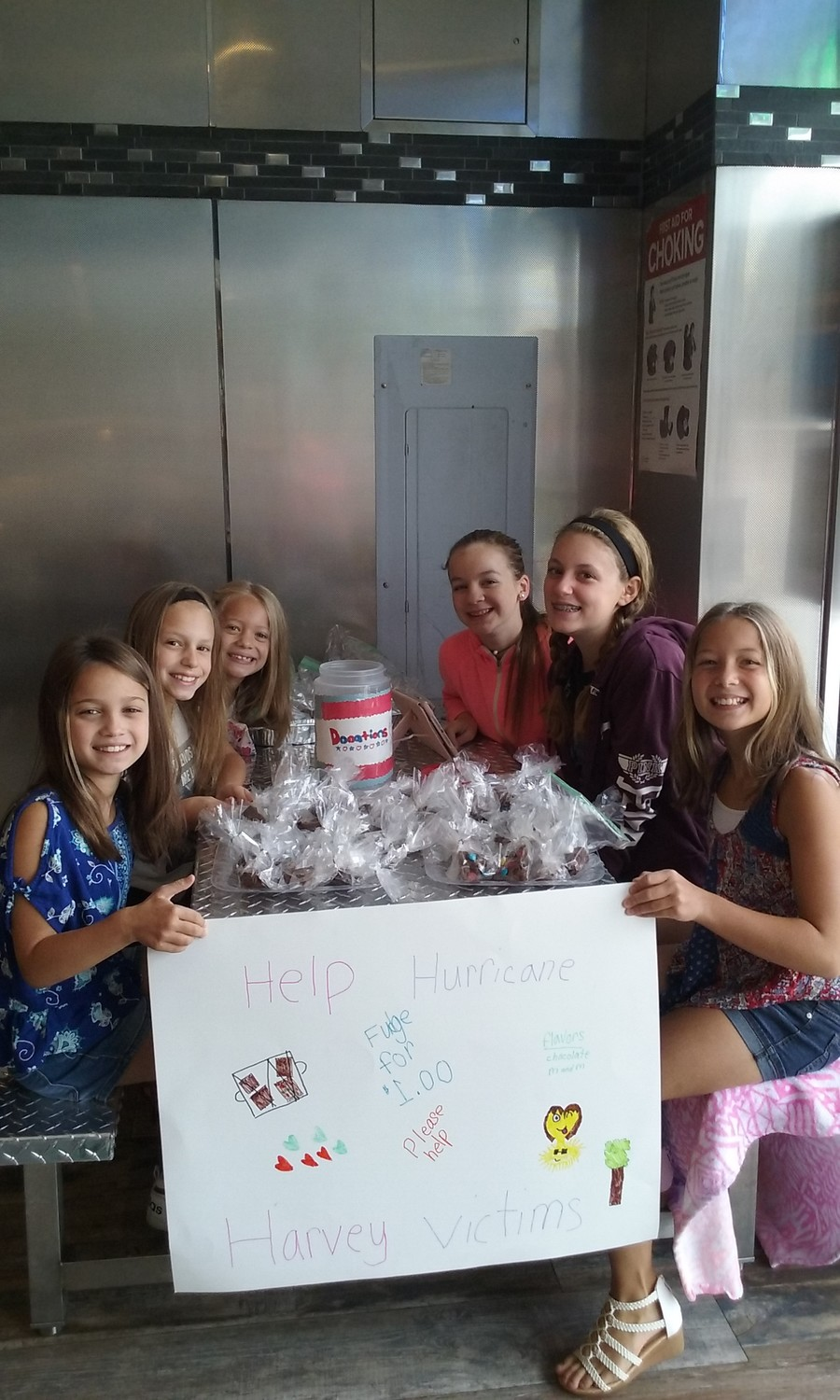 Karissa McGlynn, left, Keira McGlynn, Lani Hoffman, Lia Hoffman, Caroline Scali, Kaitlyn Scali and Kassidy McGlynn worked together to sell homemade fudge to help victims of Hurricane Harvey in Texas.