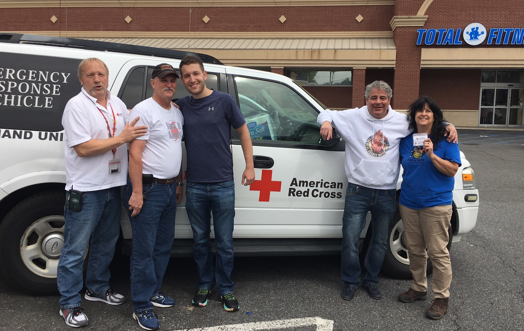 Craig Maltz, second from left, Josh Dryer and organizer Ron Steiger, joined by Red Cross personnel, helped load two trucks worth of supplies to help Hurricane Harvey victims.