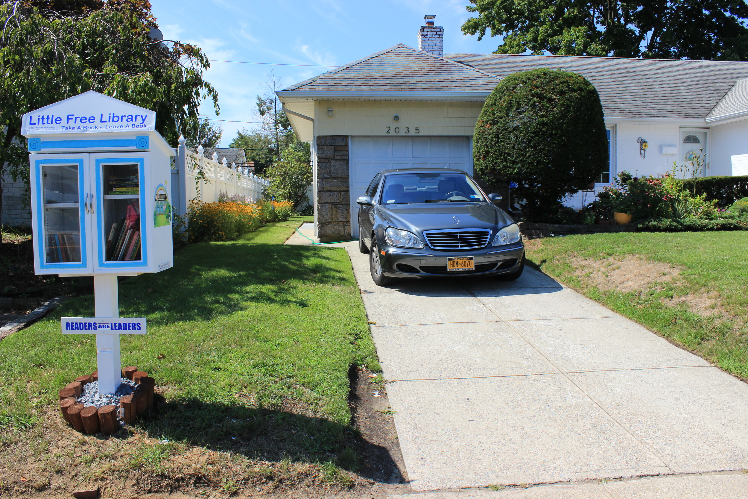 Marcia Richards-Morgan's Little Free Library sat at the end of her driveway, ready for reading enthusiasts.
