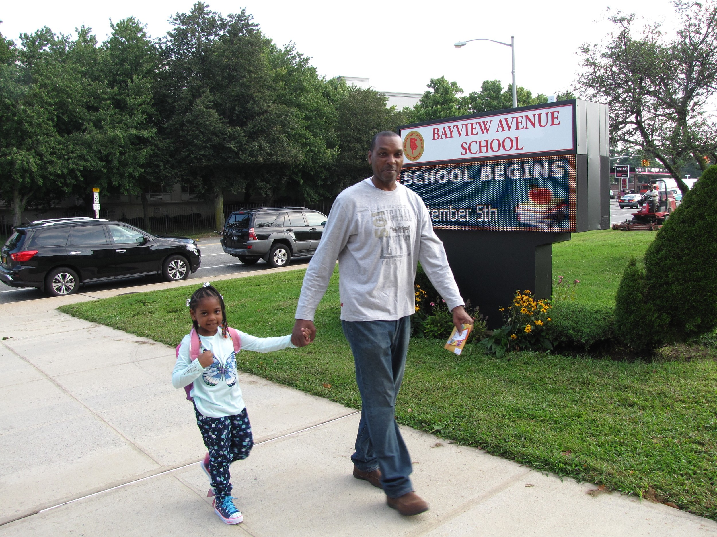 Freeport dad Kevin Curry walked his daughter Jessica to her first day of kindergarten at Bayview Avenue School.
