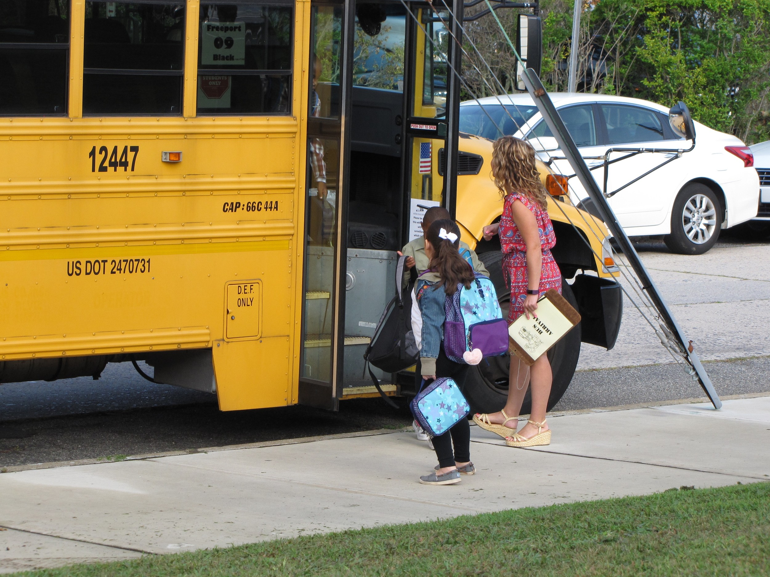 While some students walked to the Bayview Avenue School with their parents, others took the bus.