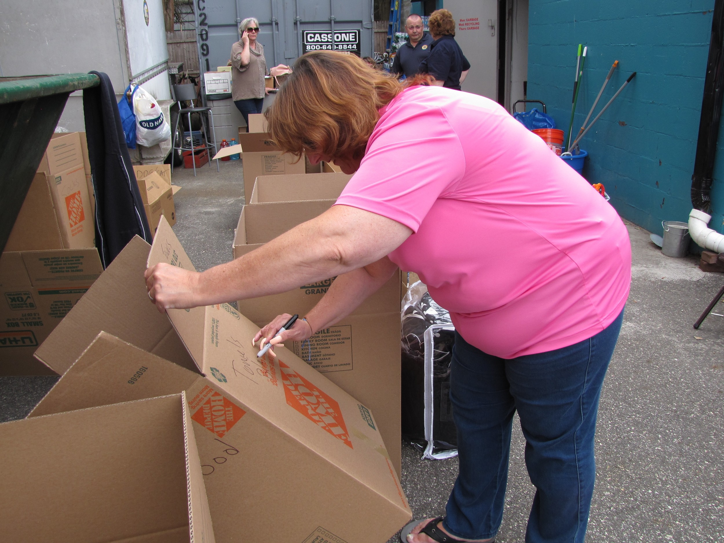 Freeport Lions Club member Sharon Moskowitz labeled a box that was filled with towels during the supply drive on Saturday.