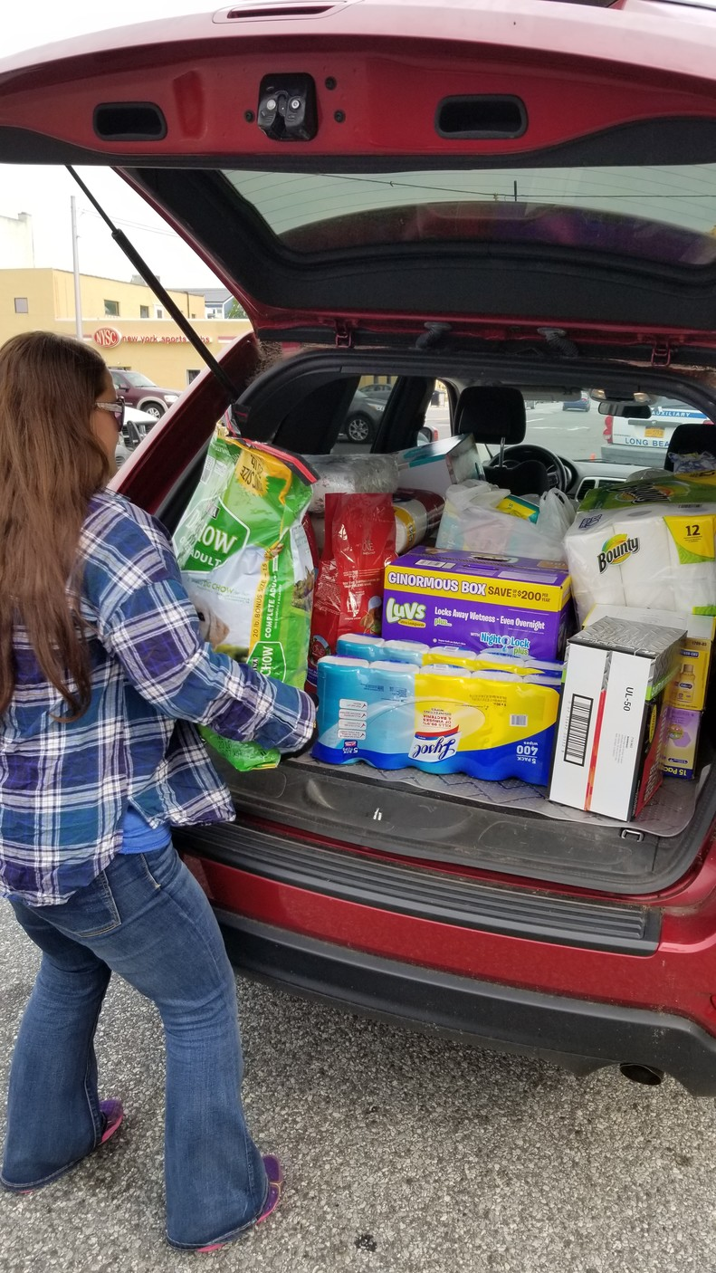 Freeporter Kristin Elmore, founder of Food is Free, unloaded donations that she collected in her neighborhood for Hurricane Harvey victims.