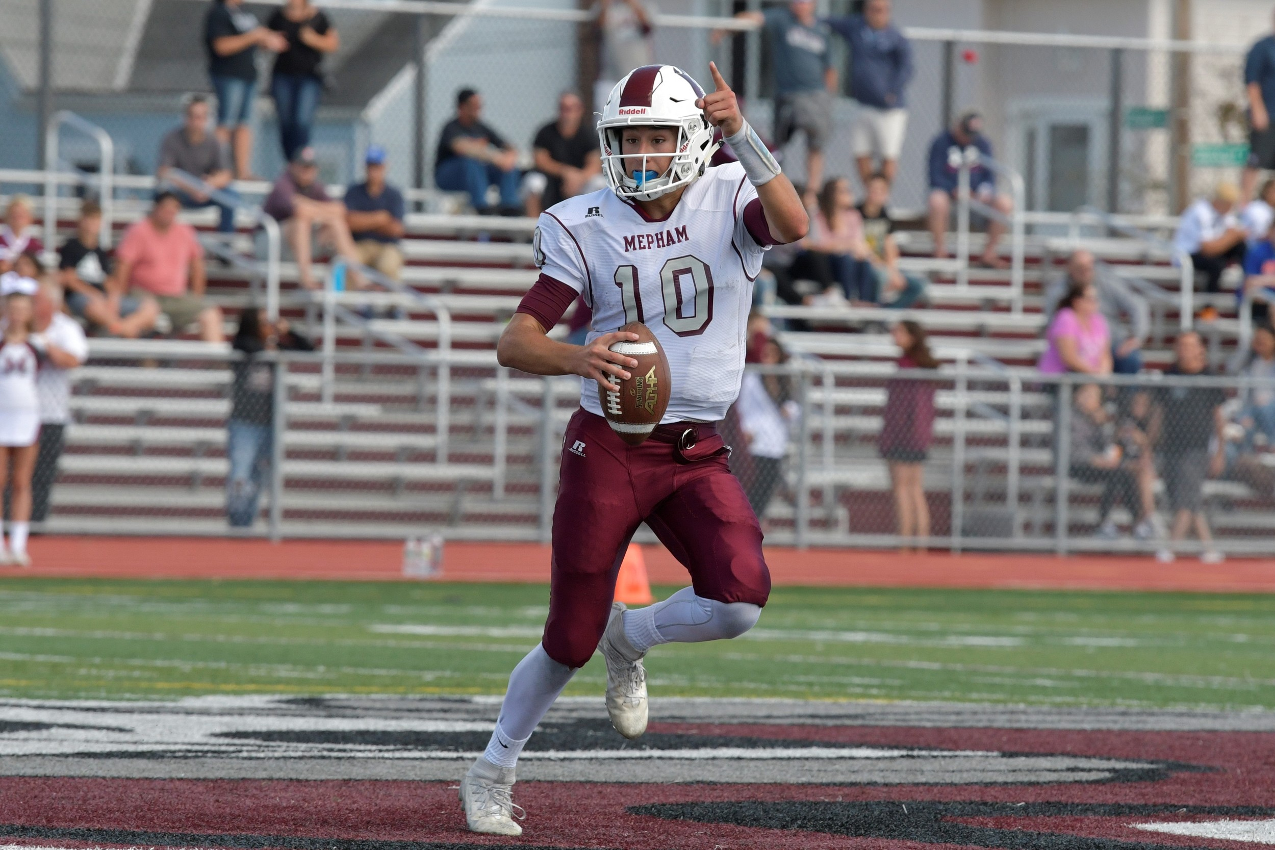 Mepham QB Mike Proios had 3 passing touchdowns and 2 rushing scores in its 35-34 season-opening win over MacArthur.