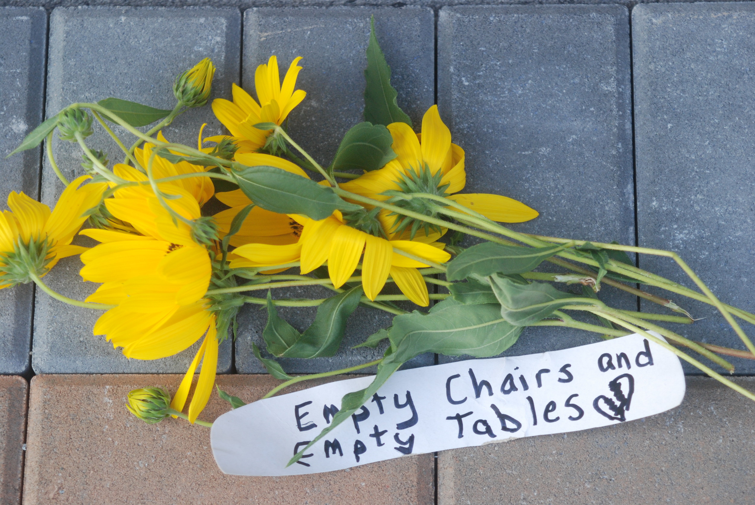 People left flowers with messages in front of the memorial.