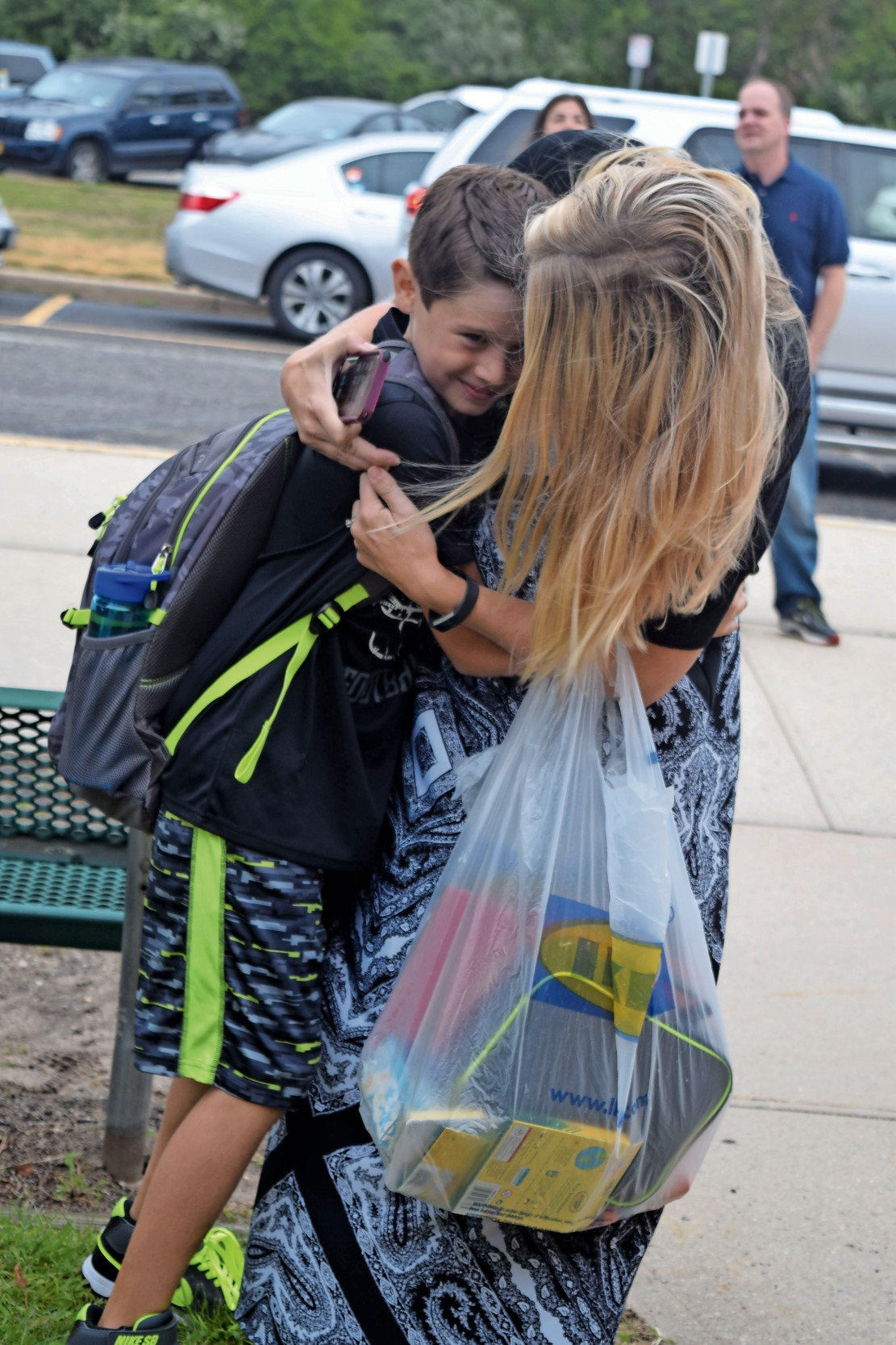 Jen DiPietro hugged her son Jack, 8, before sending him off to third grade at Harbor last year.