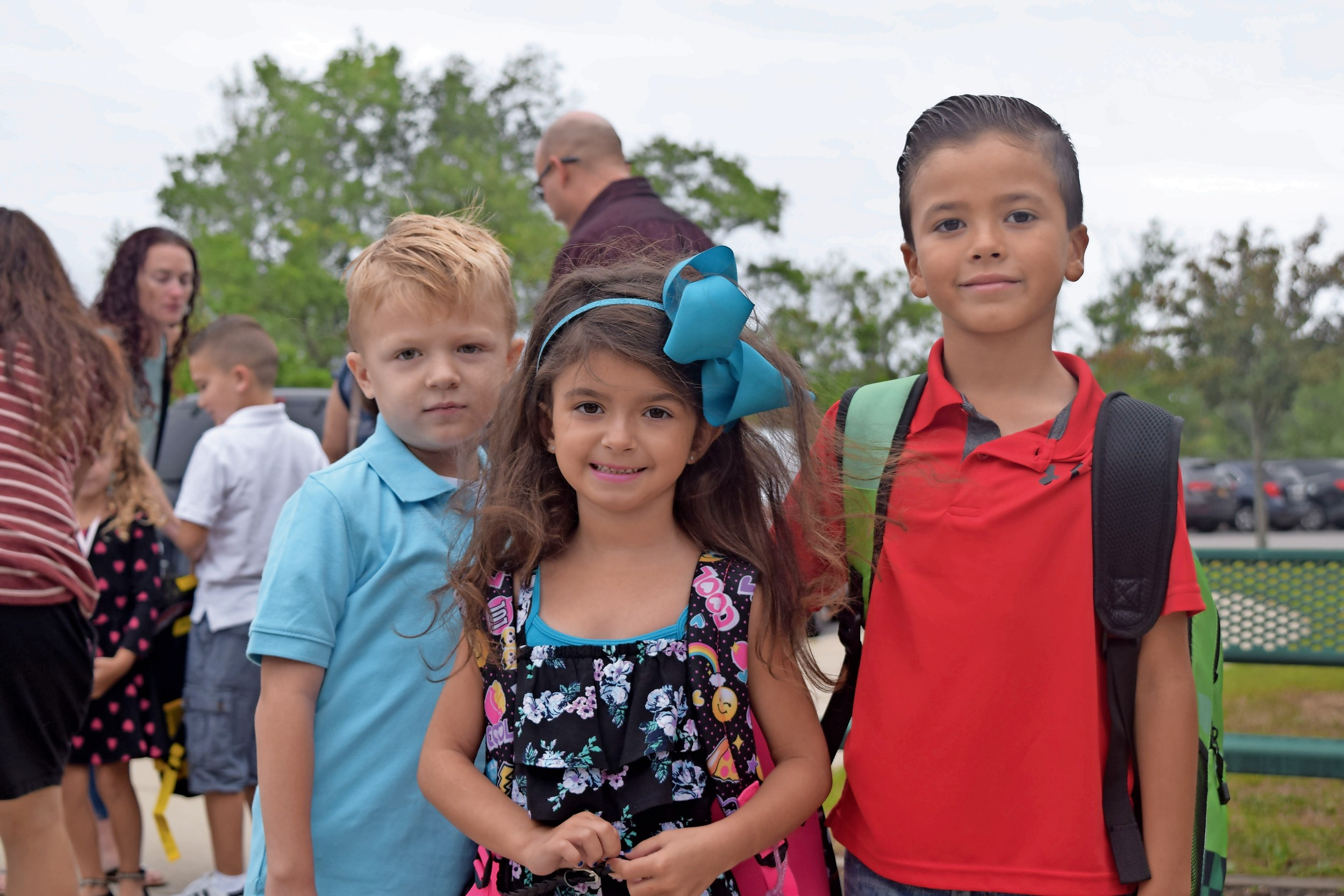 Lucas Meisenholder, 6, far left, Alessandra Saurman, 7, and Joe Vincent, 7, started a new school year at Seaford Harbor Elementary School this week. They are pictured on the first day of classes last year.