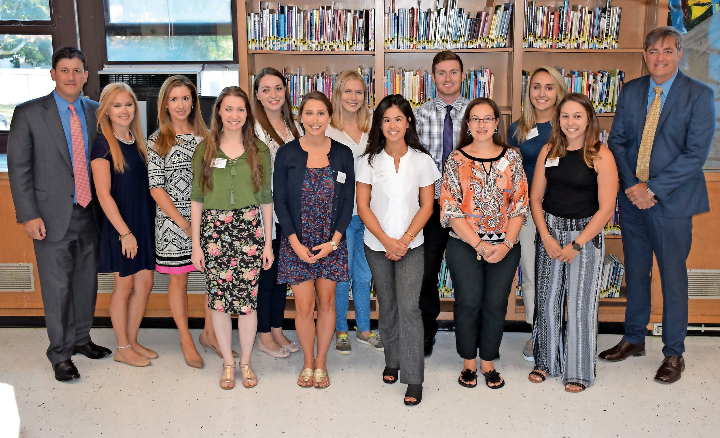 Dr. Marc Ferris, far left, Wantagh's assistant superintendent for instruction, and Superintendent John McNamara, far right, welcomed the district's new teachers during orientation on Aug. 28.