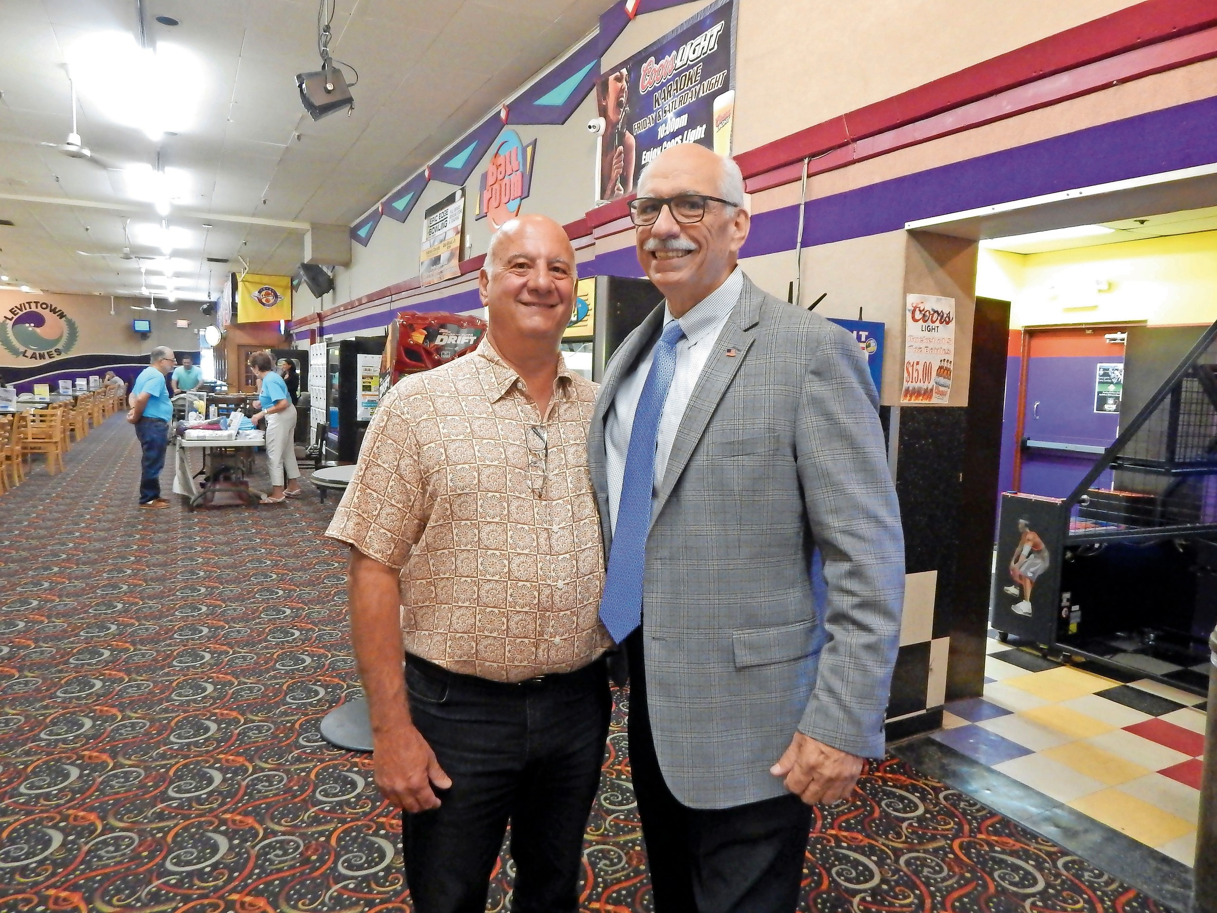 Frank Mormando, left, owner of Levittown Lanes, and Hempstead Town Councilman Dennis Dunne greeted residents.