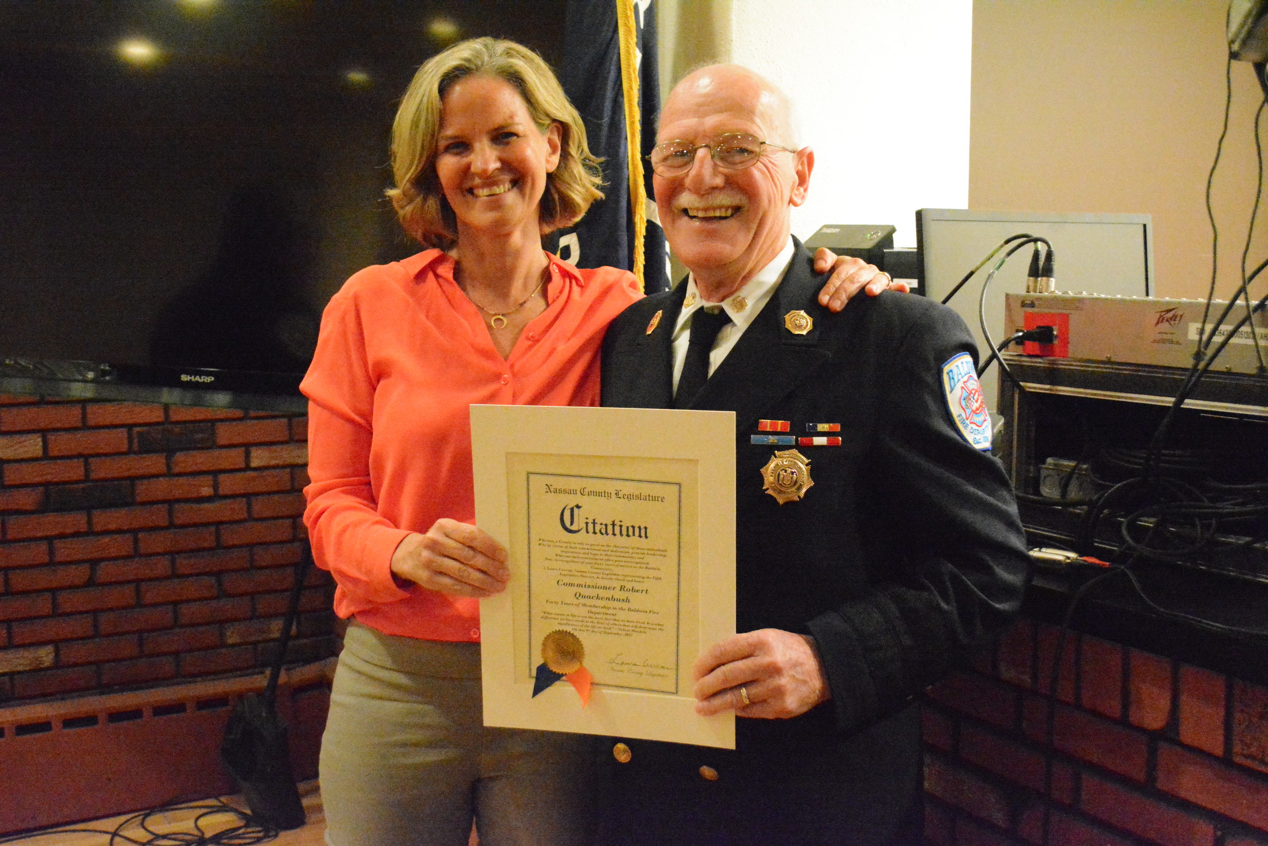 County Legislator Laura Curran presented Quackenbush with a citation in honor of his 40 years of service to the Fire Department.