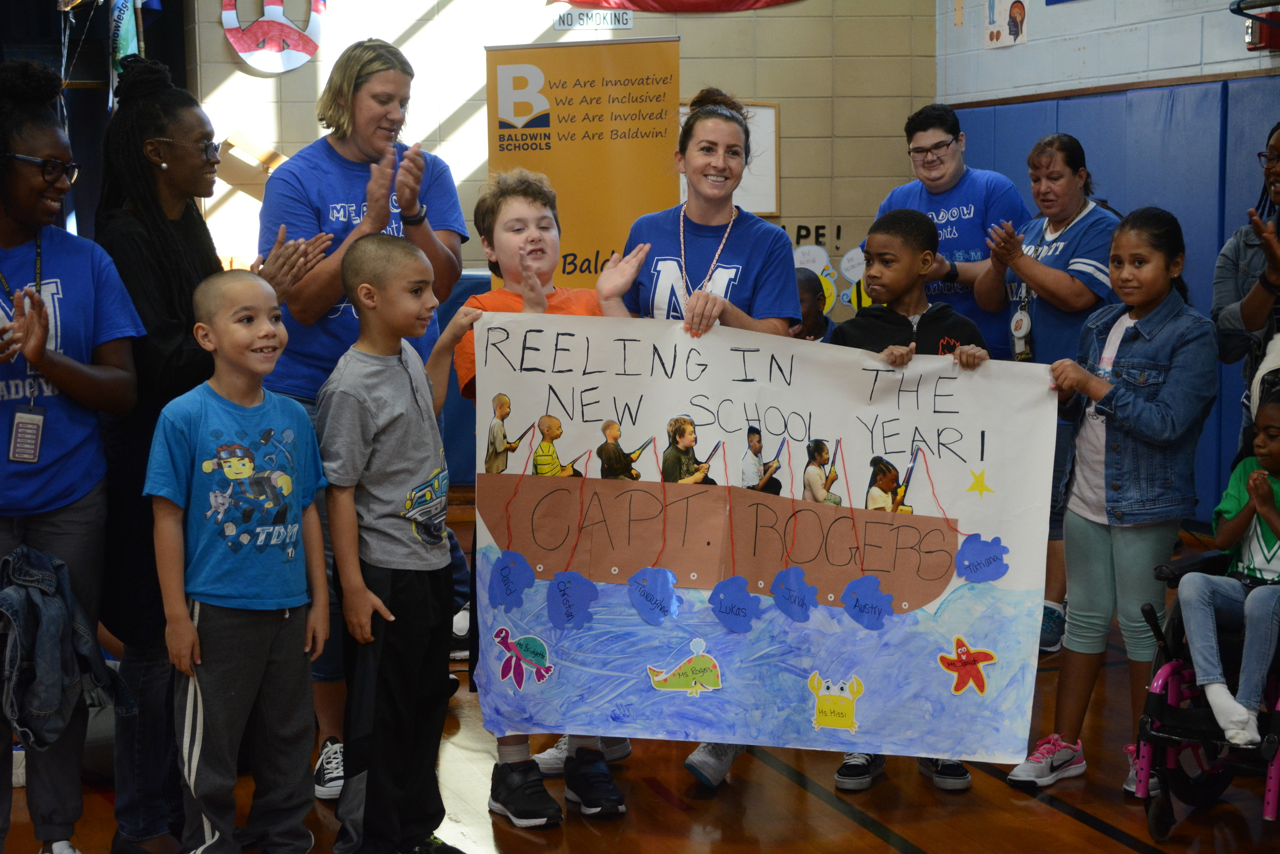 Ms. Rogers fourth grade class shows off their fishing-inspired banner during Meadow Elementary School's Pep Rally.