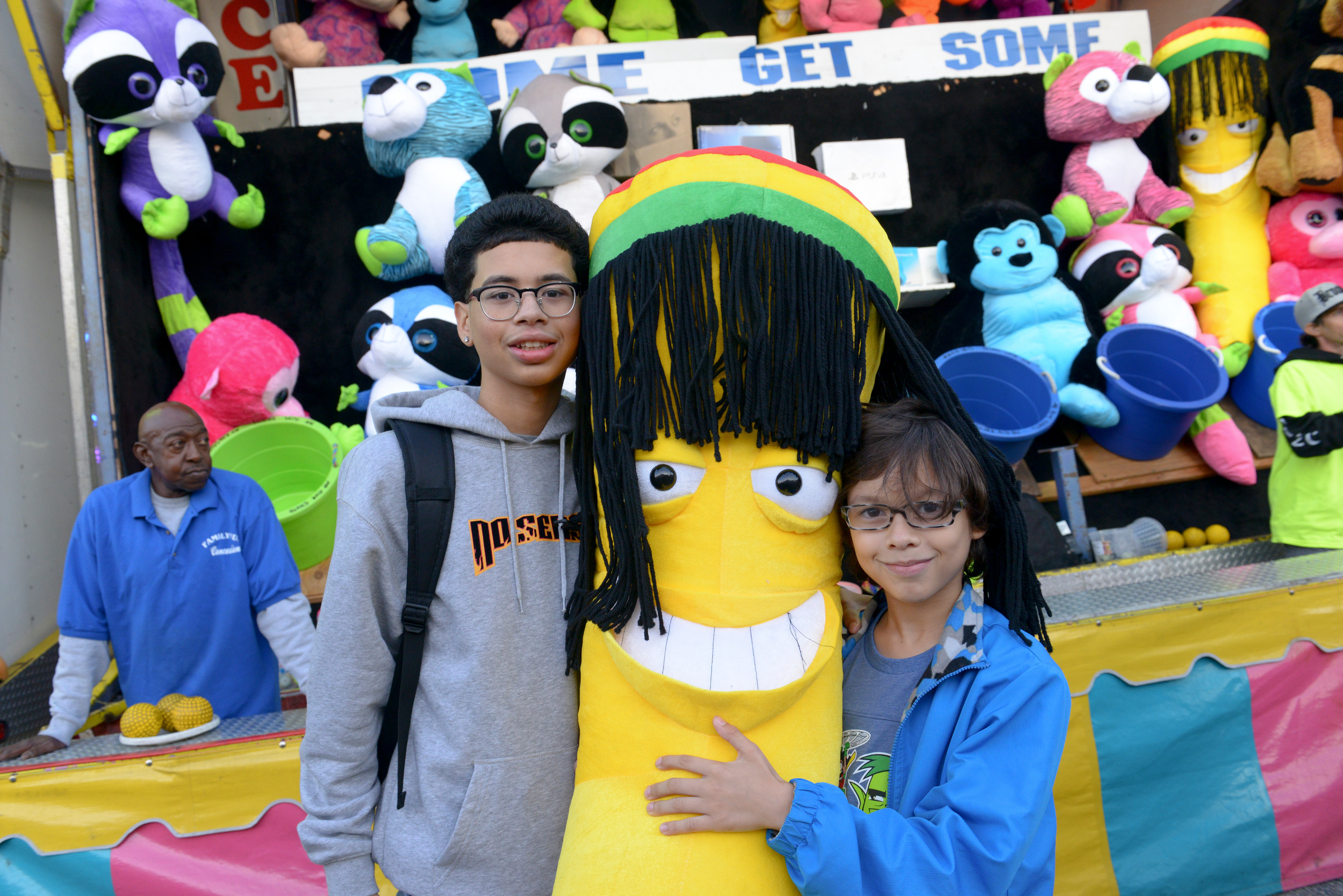 16-year-old Roberto Rosario and Ayden Medina, 9, won a stuffed Rasta banana.