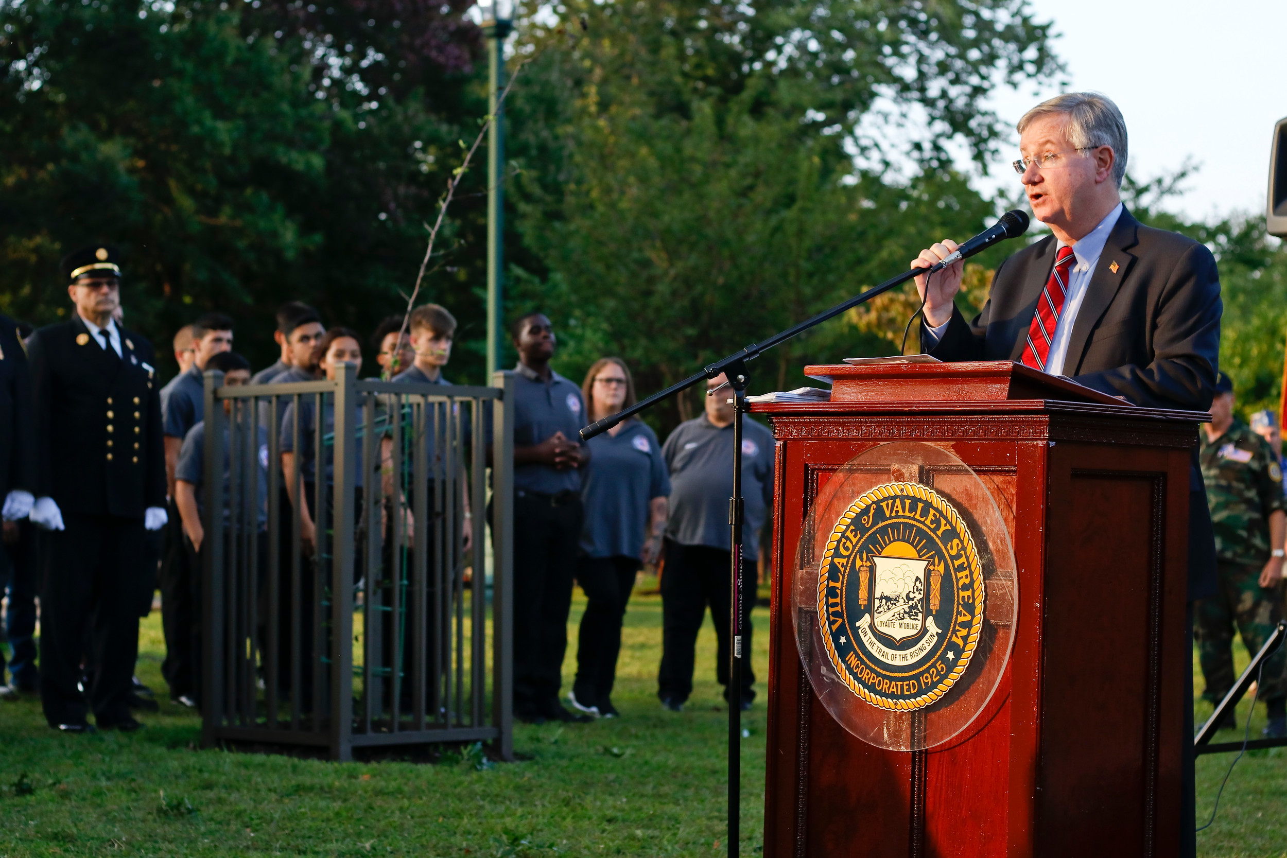 Master of Ceremonies, Jude Robert Bogle, addressed the gathered crowd of residents, fire fighters, veterans, boy scouts, girl scouts and local politicians who gathered for this years September 11 remembrance ceremony.
