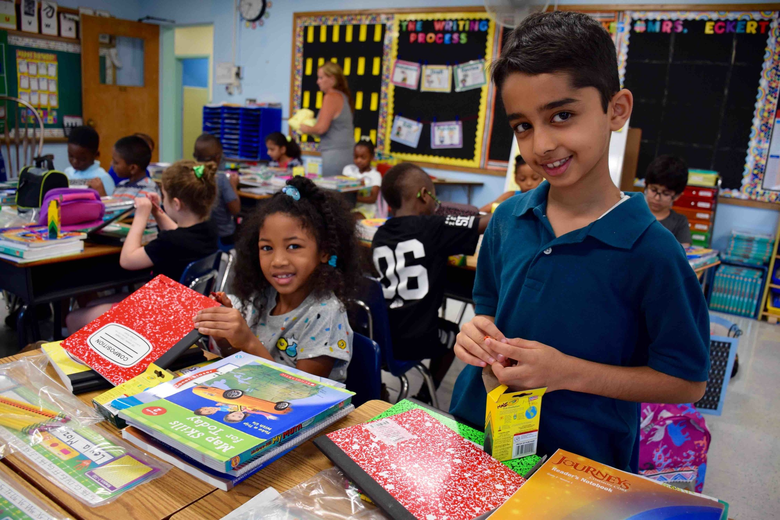 Forest Road students Hadi Sajjad, right, and Leyla Moze organized their school supplies during their first day of second grade.