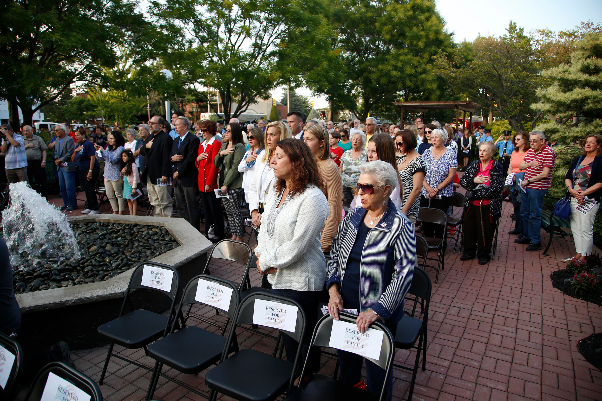 Dozens of Lynbrook residents gathered at the village's ceremony to remember the victims of the terrorist attacks of Sept. 11, 2001. (At left)