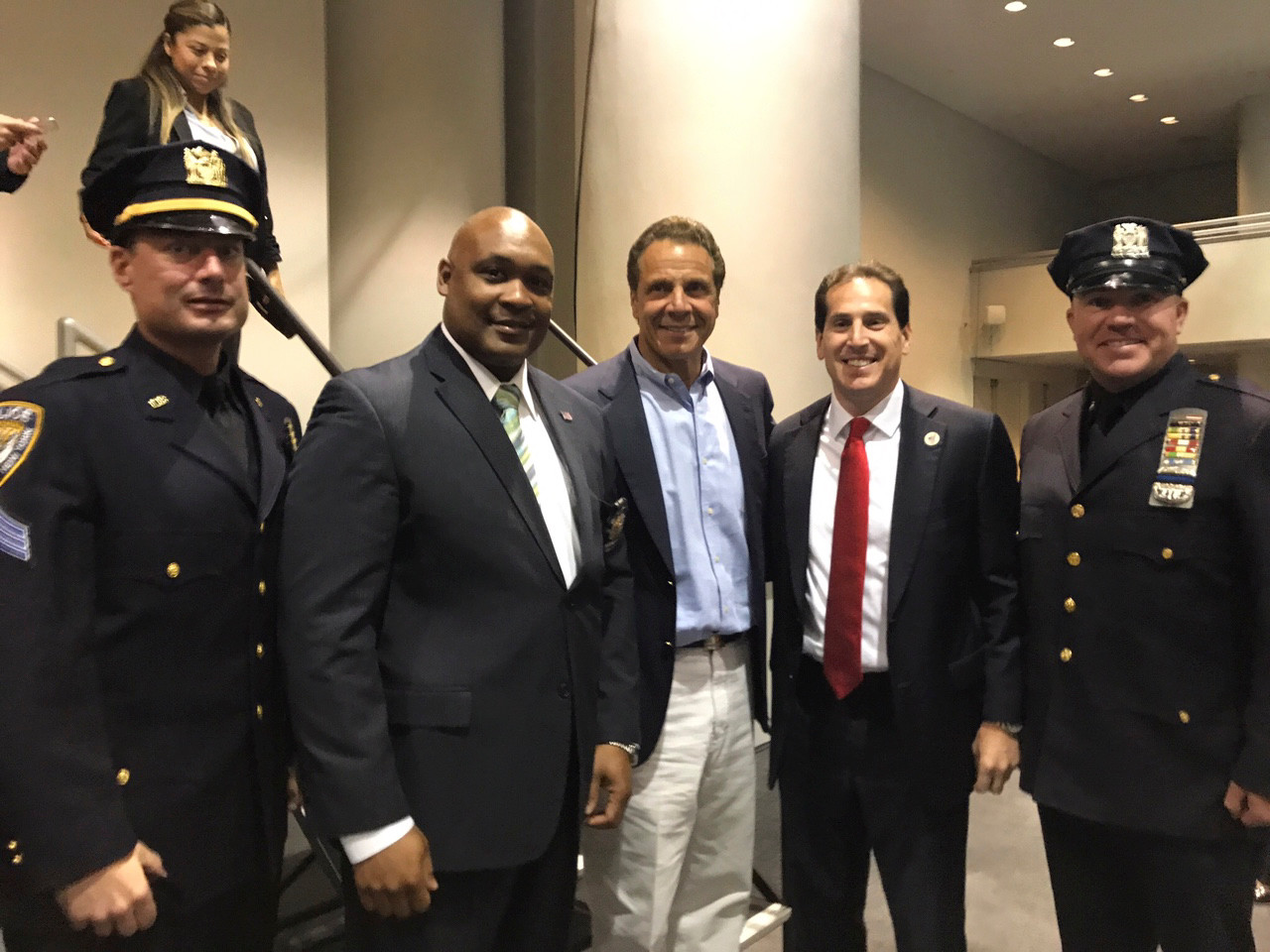 Long Beach police officer Rich DePalma, far left, detective Anderson Joseph, Governor Cuomo, State Sen. Todd Kaminsky and police officer Darren Brennan.