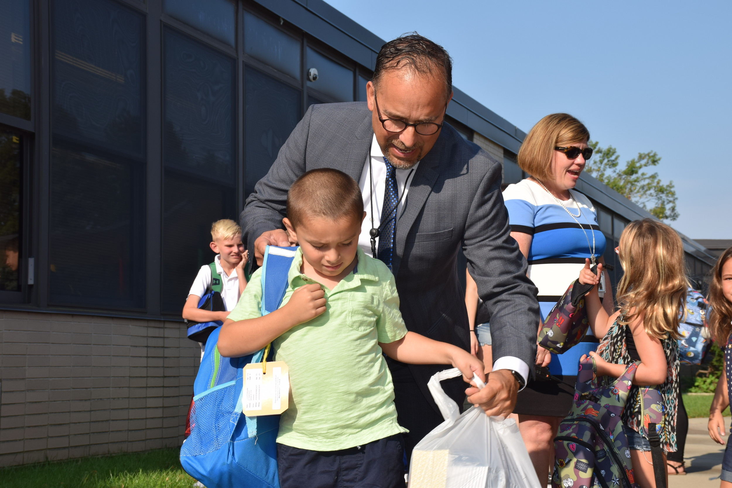 Superintendent of Schools Dr. Joseph Famularo and Principal Patricia Castine assisted students disembarking the school buses with backpacks and lunches.