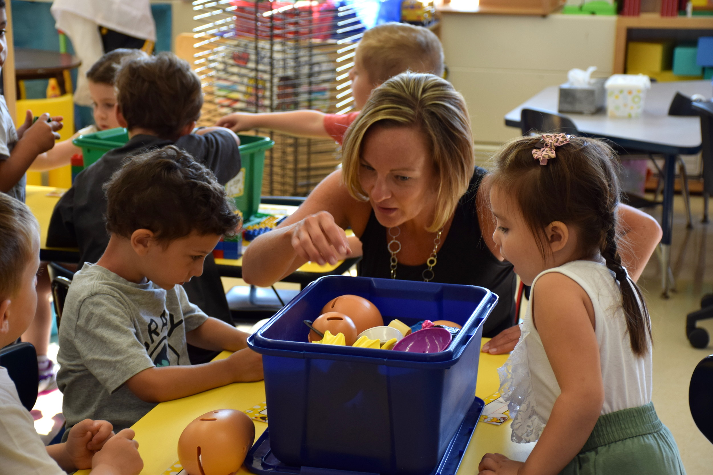 Pre-K teacher Mrs. Haines spent time meeting her new students in the classroom on the first day of school.