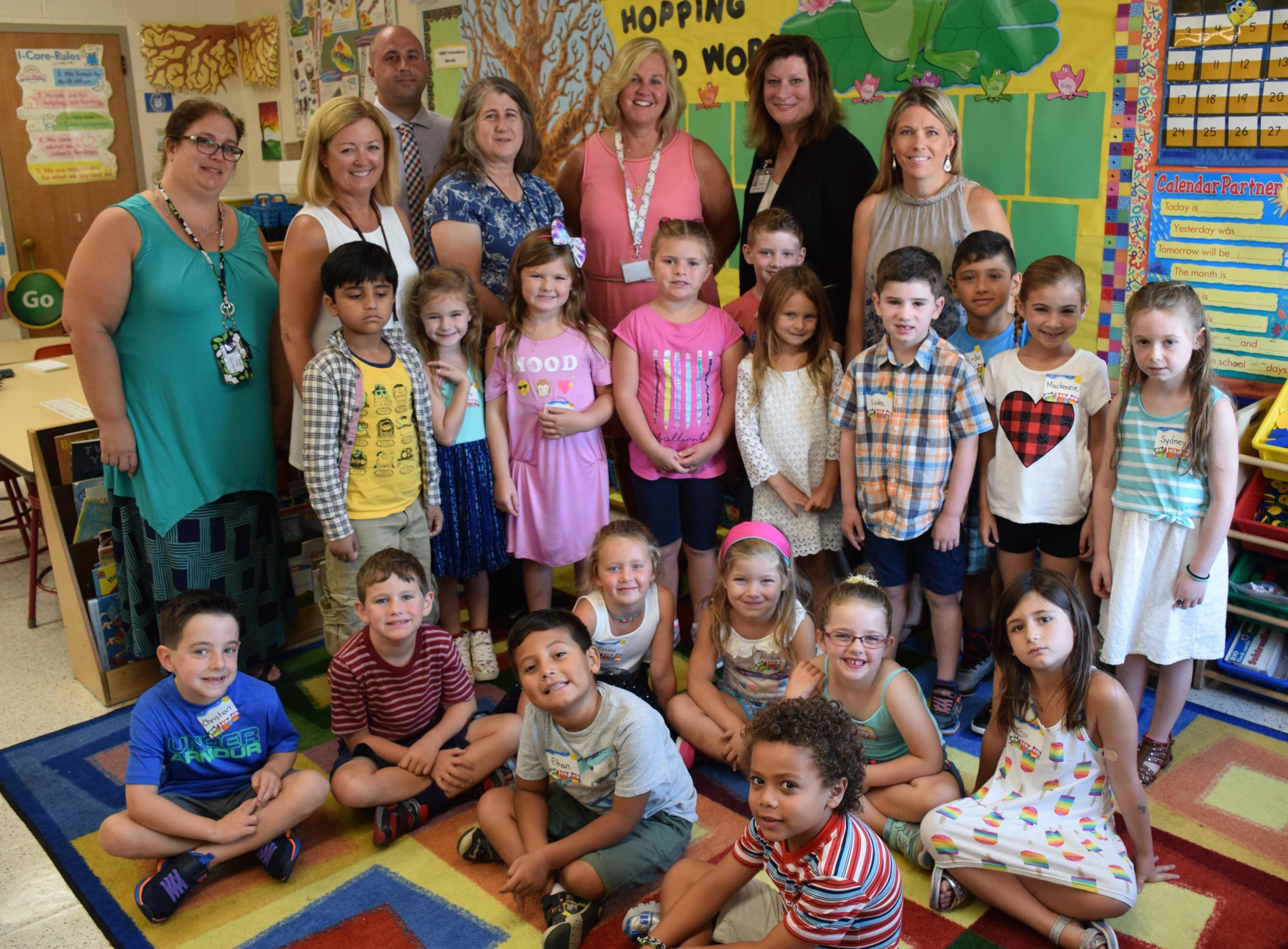Board of Education members Melissa-Cmar Grote, Peter Mayo and Joanne DeLauter, John Dinkelmeyer Elementary School Principal Faith Skelos and Superintendent Marie Testa greeted Lori Chandler's class on the first day of school. The teacher aide is pictured second from left.