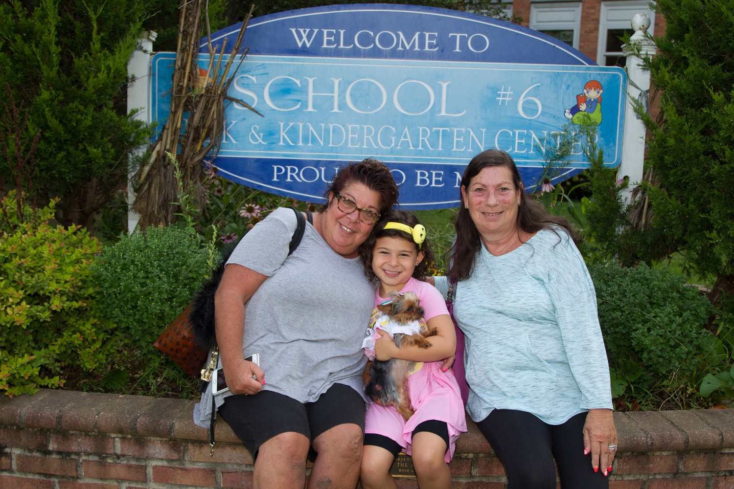 Oliva Gabel, center, brought her dog for the first day of kindergarten, with her were Lori Gabel, left, and Rosanne Krinsky.