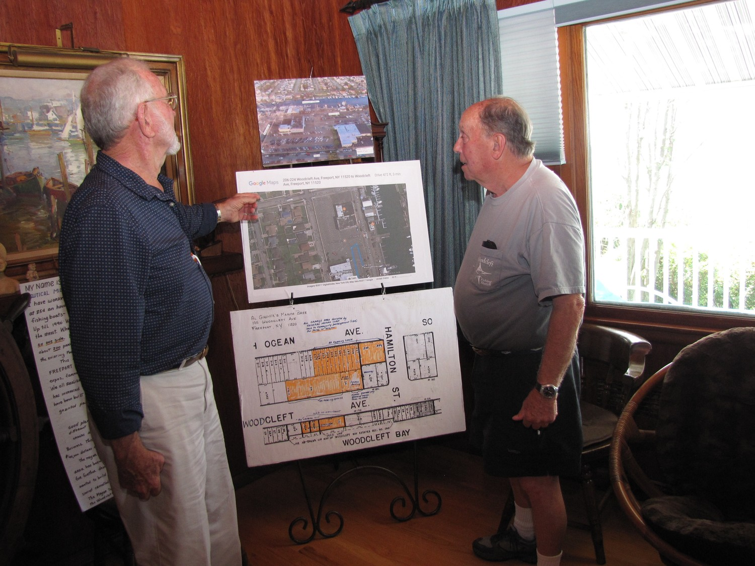 Freeporter Al Grover, left, reviewed the parking area that would be affected with Mike Kaland, owner of the Seahorse Gift Shop.