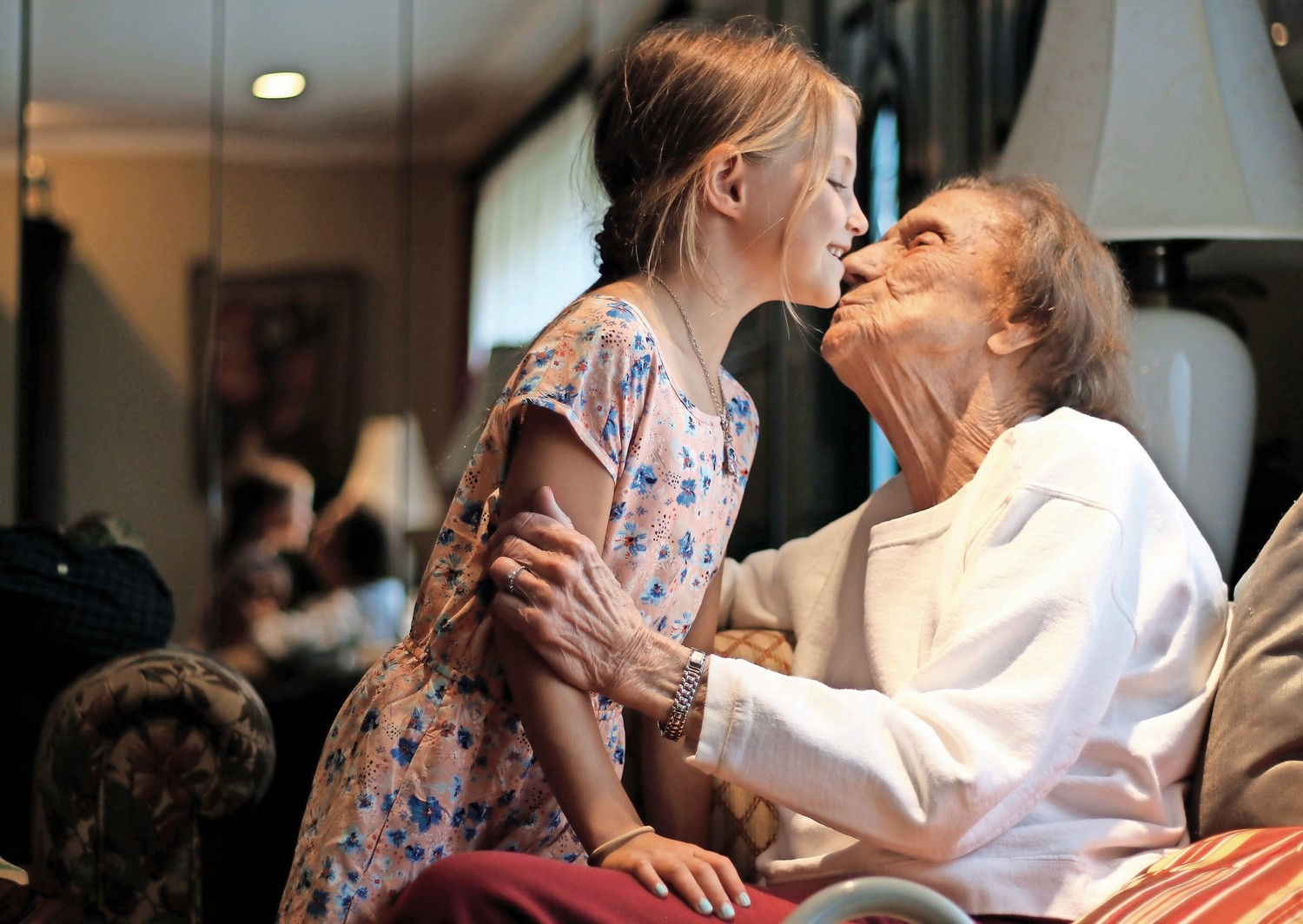 Seven-year-old Allie Younghans kissed her great-grandmother Mary Catherine Kowalski Fennessy, who will be the first in the Fennessy family to turn 100 on Sept. 17.