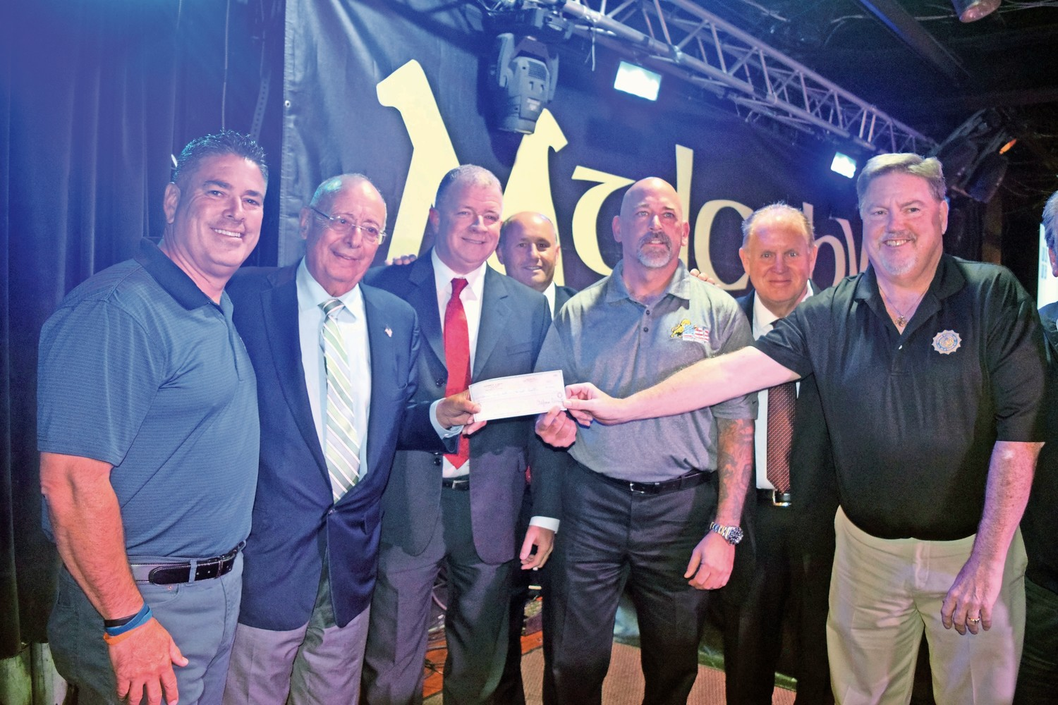 Nassau County Police unions held a fundraiser to help the victims of Hurricane Harvey at Mulcahy's Pub and Concert Hall on Sept. 6, collecting more than $120,000. From left were Nassau County PBA President James McDermott; Al D'Amato, a former U.S. senator; COBA President Brian Sullivan; Police Commissioner Patrick Ryder; DAI President John Wighaus; John Murray, the owner of Mulcahy's; and SOA President Kevin Black announced that D'Amato donated $50,000.