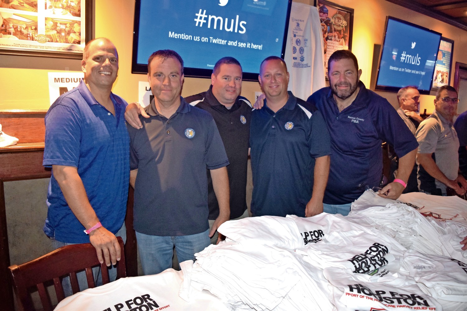 Police Benevolent Association members sold T-shirts and raffles to raise money for Help For Houston at Mulcahy's in Wantagh.