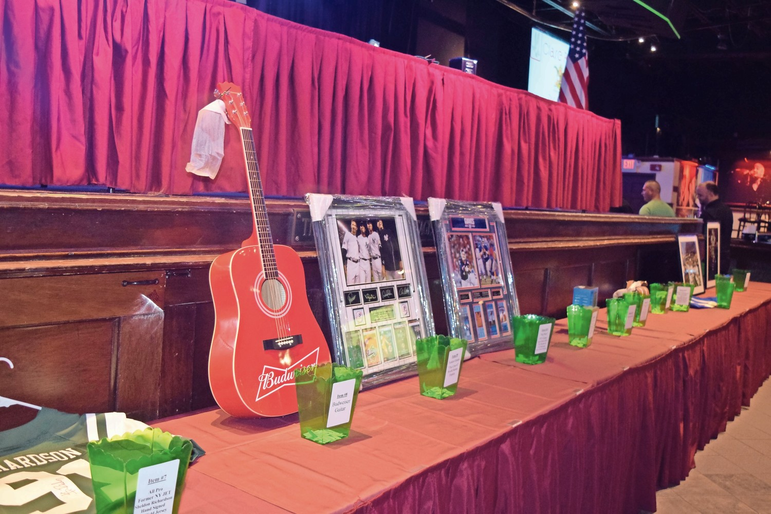 Raffle and auction items, including Michael Kors handbags and football memorabilia, were provided by the John Theissen Children's Foundation.