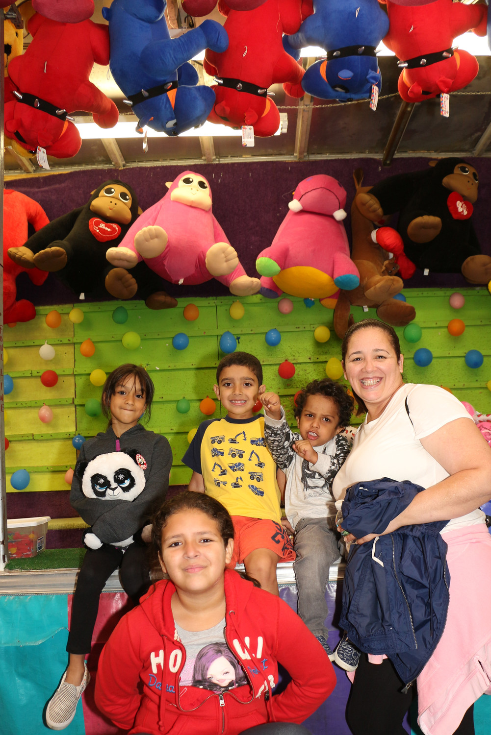 Judy Velesquez with her children and friends. Eliza, 6, Layla Depaz, 6 , Sebastian Depaz, 4, and Laura Velesquz, 8, playing many games at the carnival.