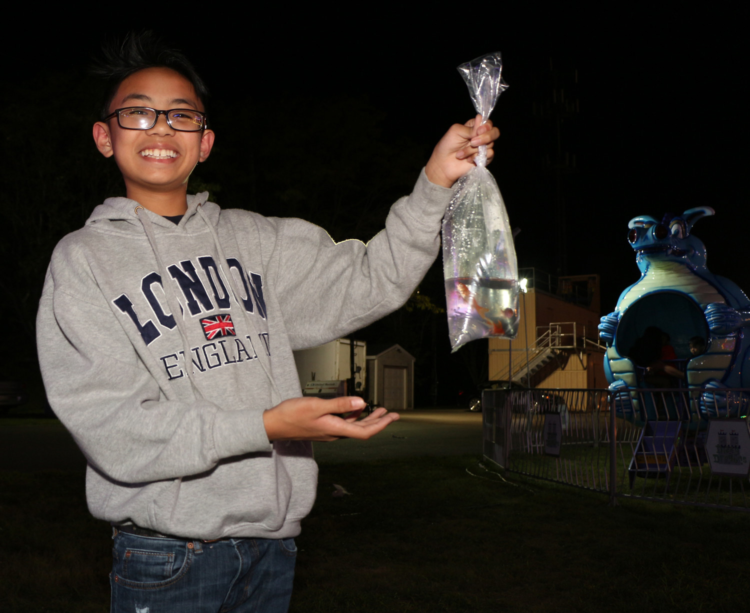 Jharrel Berardo carries a few goldfish to take home as pets.