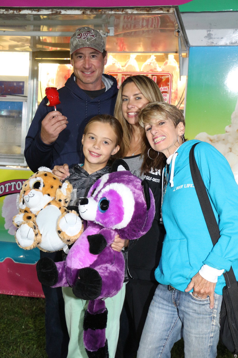 The Zaremba family are out for sweet treats and fun at the Baldwin Fire Department's Carnival. Alexis Zaremba, 9 , Aunt Debbie Coscia, Tracey-mom, and Joe-Dad.