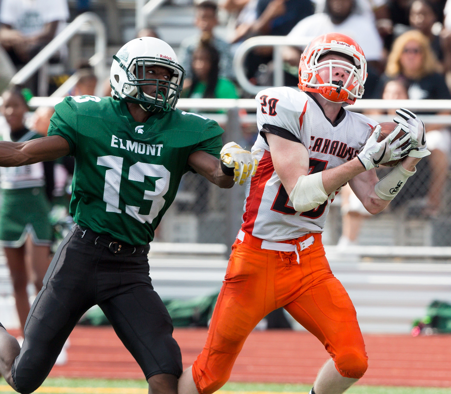 Senior Barry Moore, right, caught a long touchdown pass in the first quarter and added two more scores for Carey in last Saturday's 49-27 victory at Elmont.