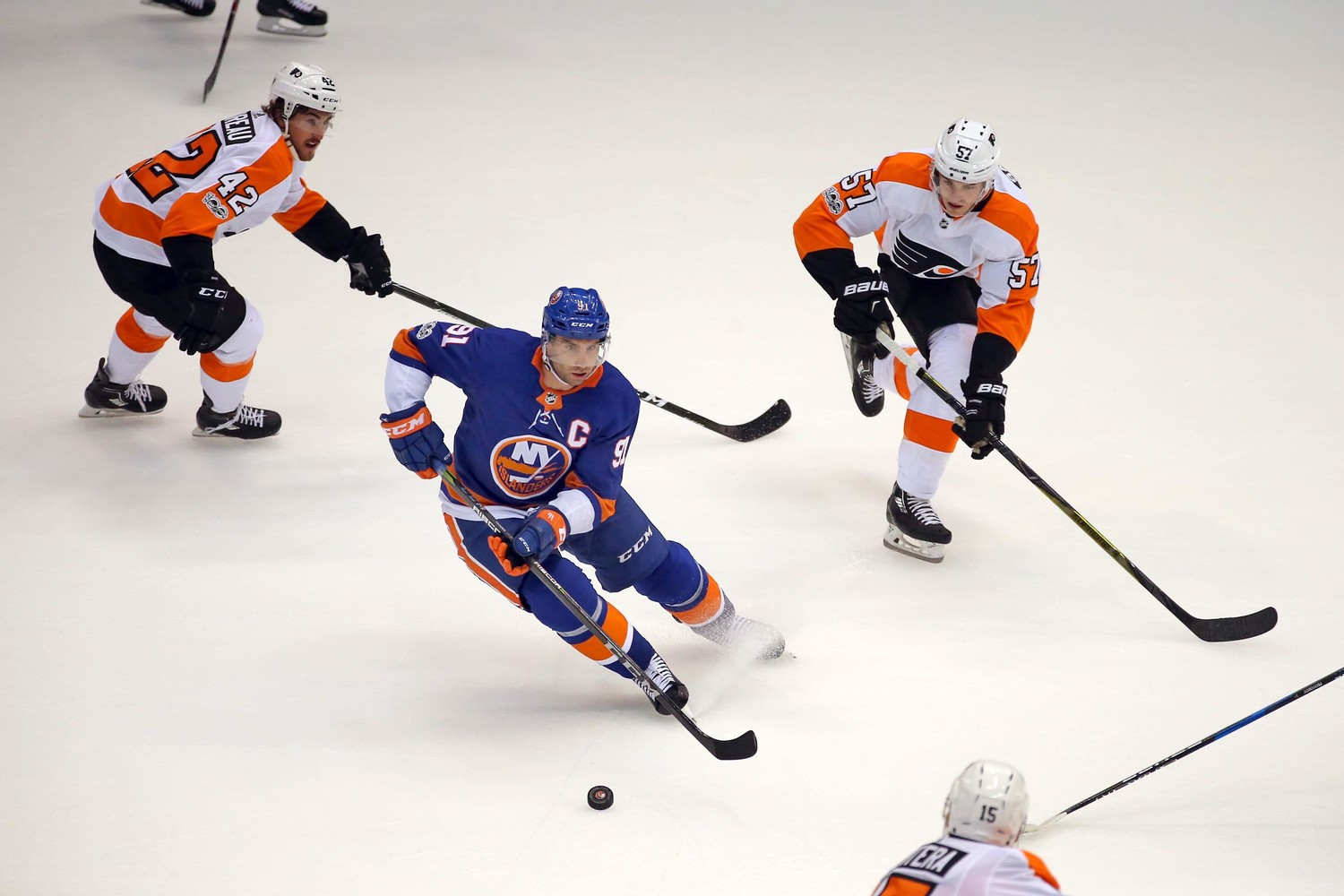 Islanders captain john Tavares scored two goals, including the overtime winner, in the team's preseason opener at NYCB Live's Nassau Veterans Memorial Coliseum on Sunday.