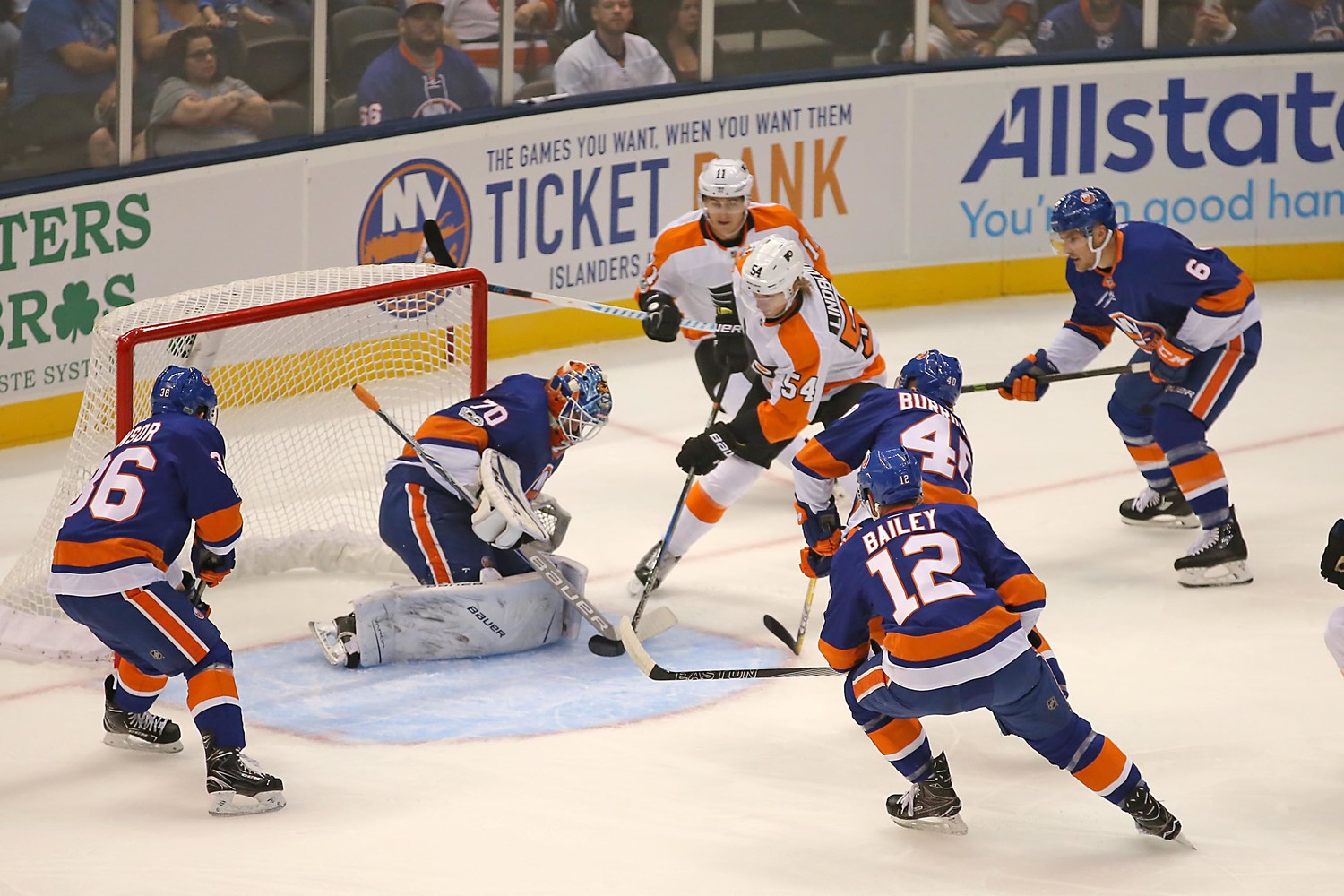 The islander 's goalie Kristers Gudlevskis, right, made a save on a shot by the Flyers Oskar Lindblom.