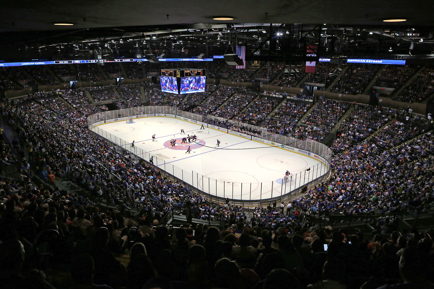 In a preseason contest, 13,917 fans returned to the renovated Nassau Coliseum to watch the sold-out game as the Islanders beat the Philadelphia Flyers 3-2 in overtime.