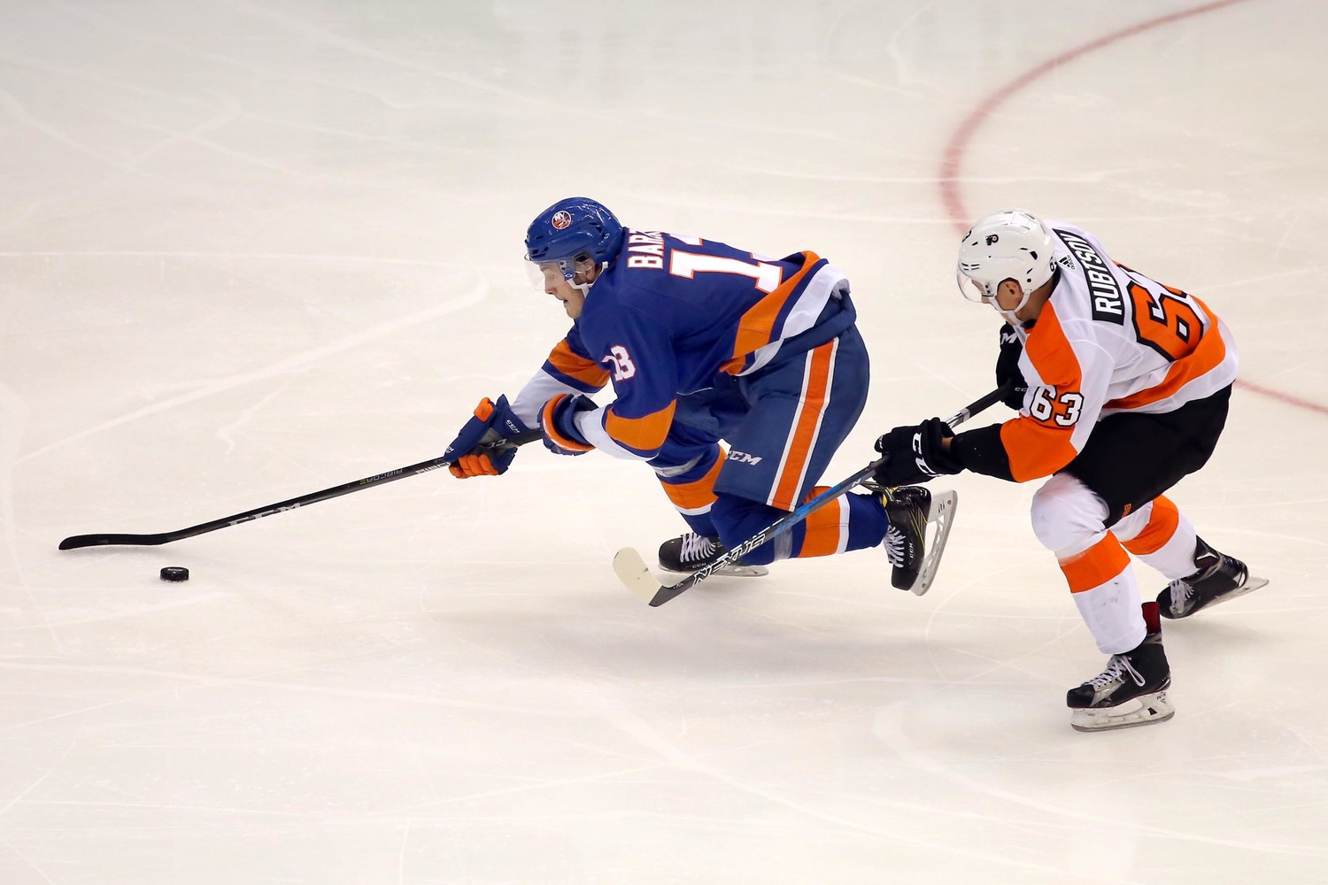 Flyer's German Rubtsov tried to steal the puck from Islander's Mathew Barzal.