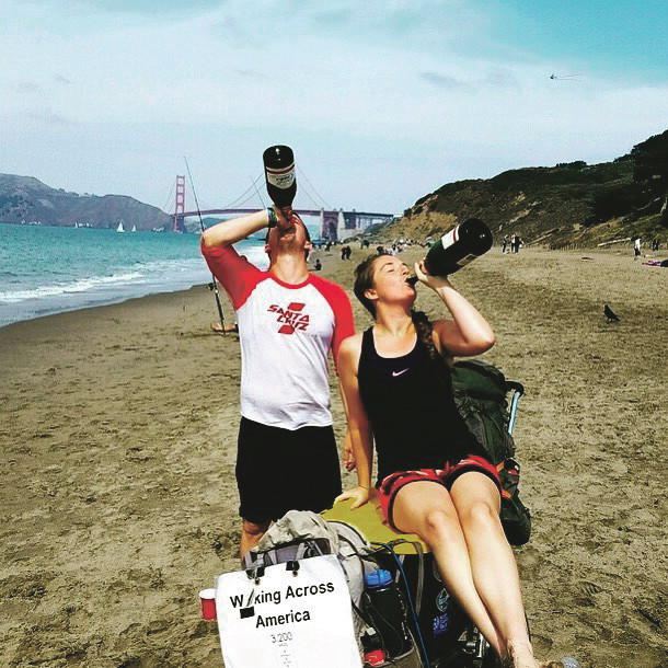 Rockville Centre's Daniel Finnegan and his walking companion Abby Bongaarts celebrated the end of their 3,200-mile cross-country trek with champagne at Baker Beach on Sept. 16, in sight of the Golden Gate Bridge.