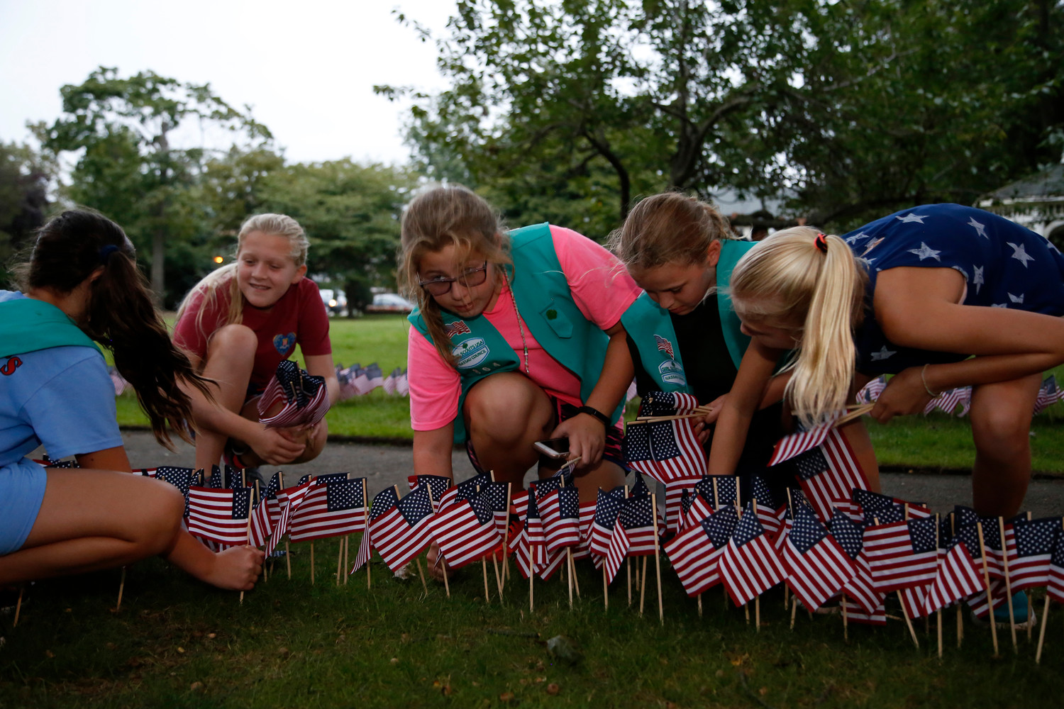 """One flag for each life lost,"" Girl Scout Troop leader Dinah Finora, not pictured, said, as her scouts helped prepare for the 9/11 memorial on the Village Green."
